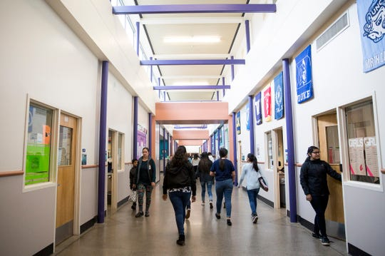 Students walk through the halls at Adam Stephens Middle School in Salem Jan. 10, 2019.