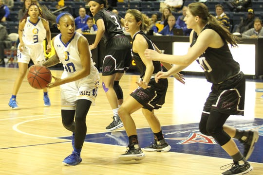 Angelo State University's Marquita Daniels (10) looks for an open teammate during a Lone Star Conference women's basketball game against West Texas A&M at the Junell Center on Saturday, Jan. 12, 2019.