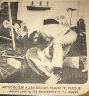 San Angelo artist Roger Allen secures figures to a plaque before placing the decorations at Holy Angels Church in 1975.
