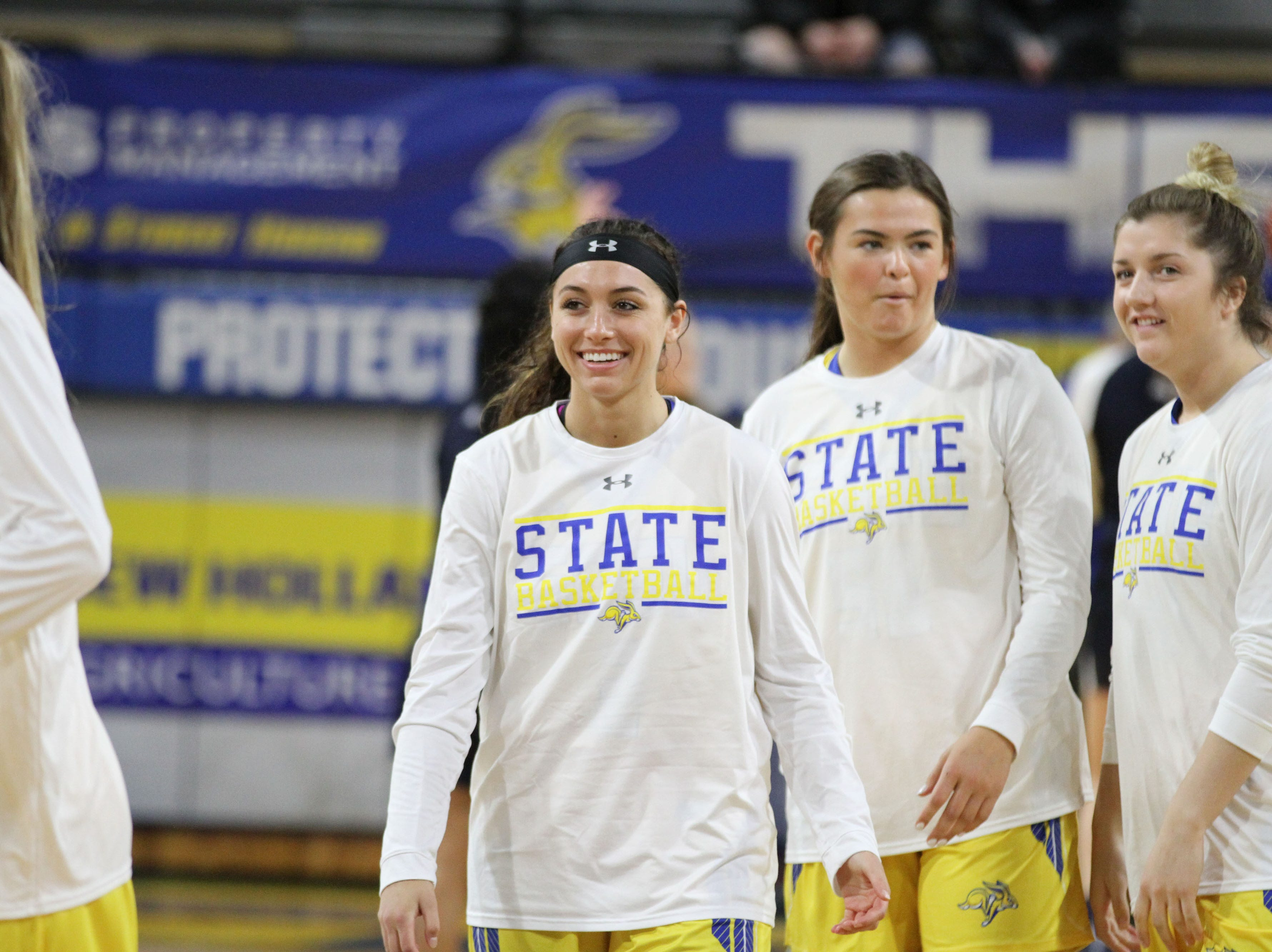 South Dakota State's Rylie Casio Jensen (middle) gives a smile before the matchup against Oral Roberts Saturday afternoon at Frost Arena in Brookings.