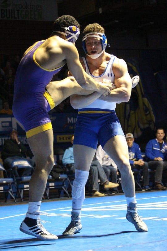 Martin Mueller (right) of SDSU battles Tyrell Gordon of UNI Friday night at Frost Arena
