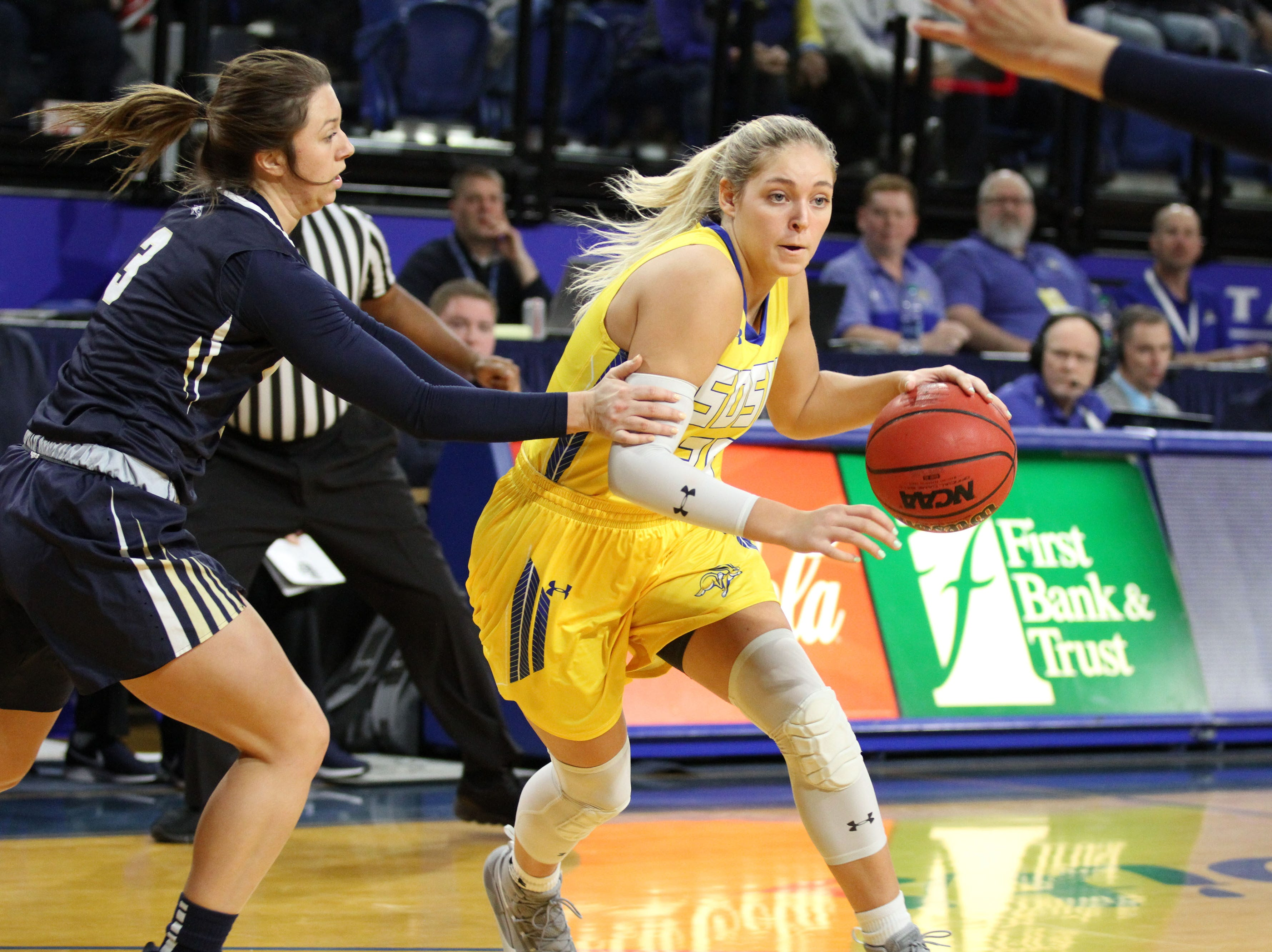 South Dakota State's Sydney Stapleton (35) drives to the bucket past Oral Roberts' Katie Kirkhart during the second quarter of the Jackrabbits' matchup against the Golden Eagles Saturday afternoon at Frost Arena in Brookings.