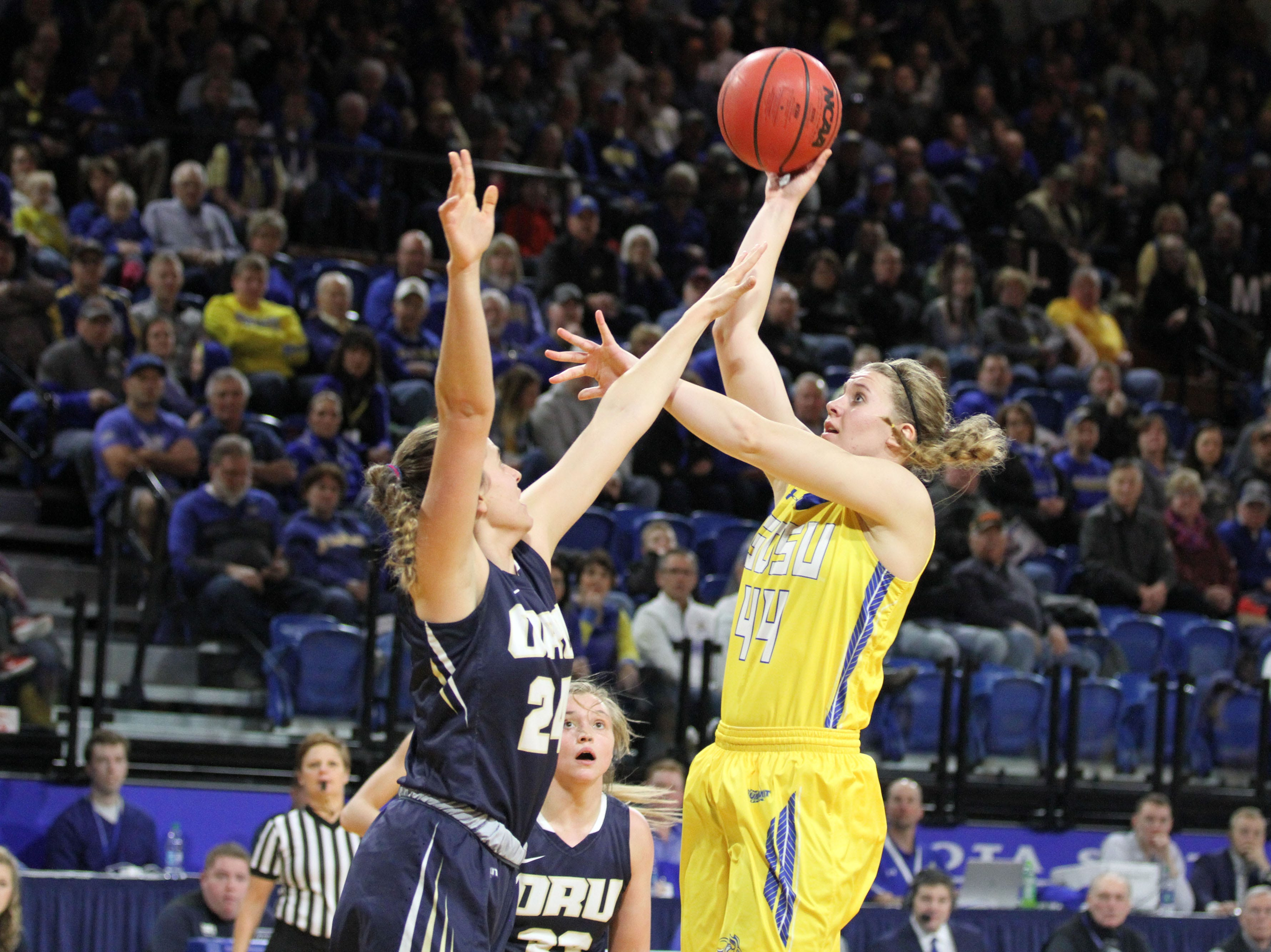 South Dakota State's Myah Selland (44) scores on a jumper over Oral Roberts' Montserrat Brotons during the second quarter of the Jackrabbits' matchup against the Golden Eagles Saturday afternoon at Frost Arena in Brookings.