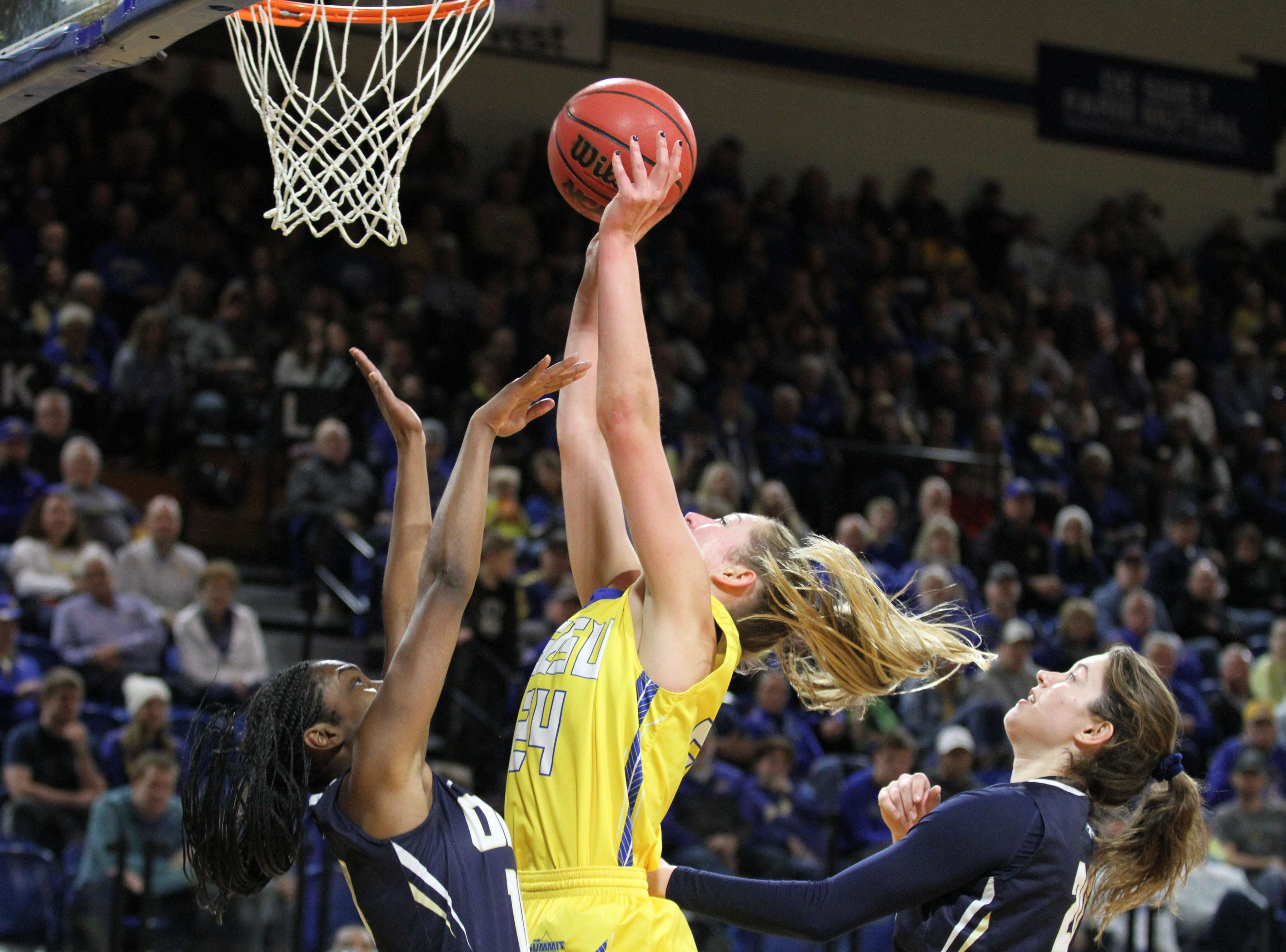 South Dakota State's Tagyn Larson (24) scores in the paint over Oral Roberts' Jasmyne May during the second quarter of the Jackrabbits' matchup against the Golden Eagles Saturday afternoon at Frost Arena in Brookings.