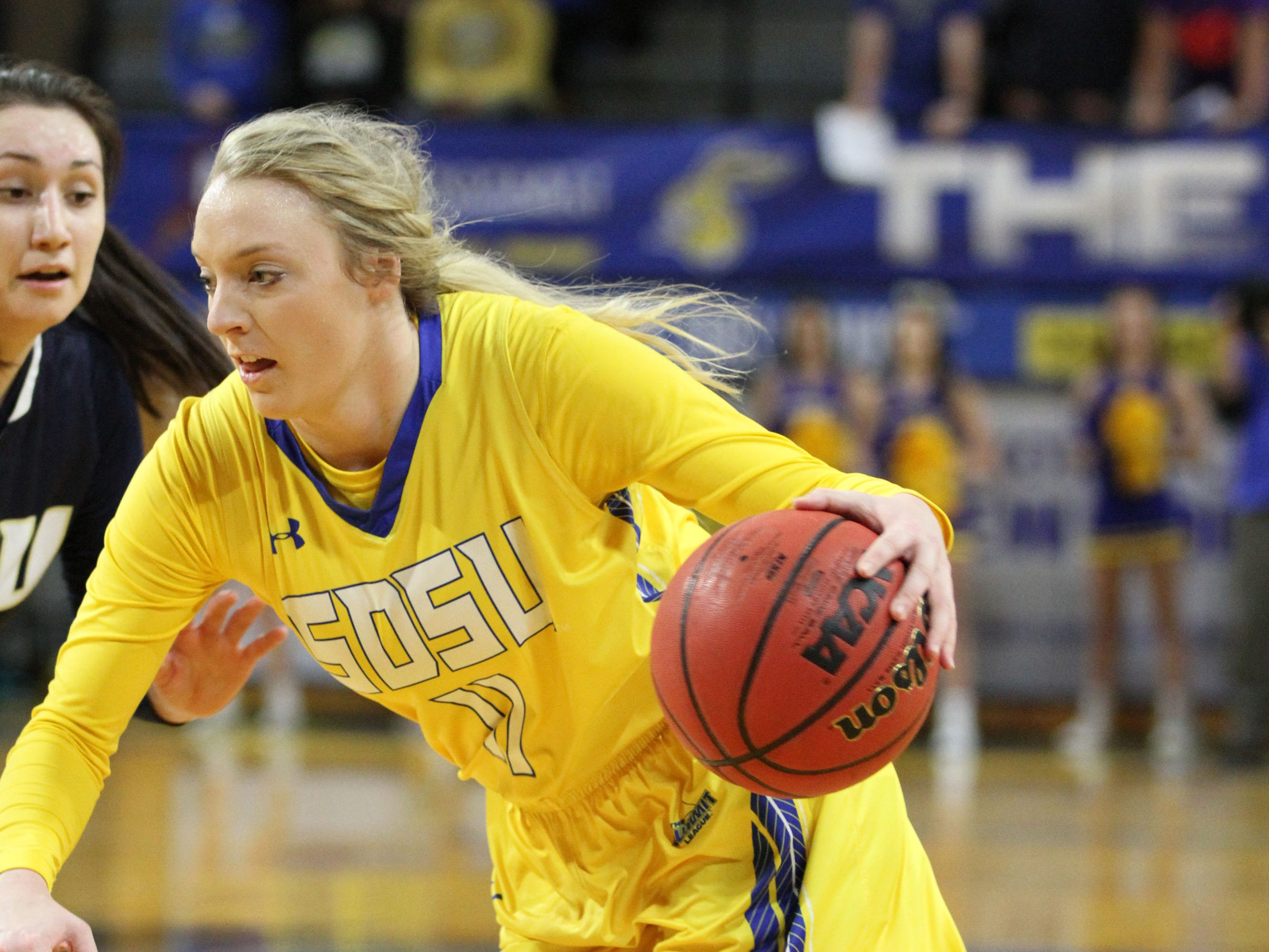 South Dakota State's Madison Guebert (11) drives to the basket past Oral Roberts' Lakota Beatty during the first quarter of the Jackrabbits' matchup against the Golden Eagles Saturday afternoon at Frost Arena in Brookings.
