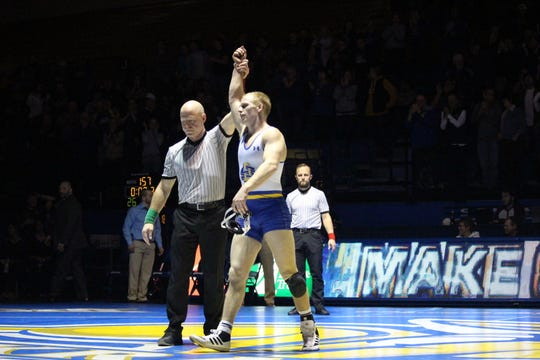 Colten Carlson is declared the winner in his match at 157 pounds Friday night at Frost Arena