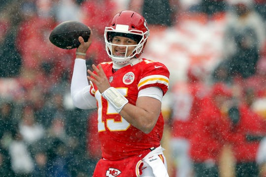 Kansas City Chiefs quarterback Patrick Mahomes (15) warms up as snow falls before an NFL divisional football playoff game against the Indianapolis Colts in Kansas City, Mo., Saturday, Jan. 12, 2019.