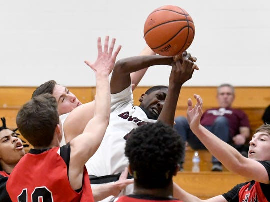 Stuarts Draft's Zakar Woodson (center) battles for the rebound during their game in the Rock the Ribbon Roundball Shootout in Lexington on Friday, Jan. 11, 2019.