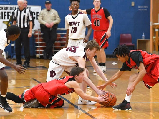Stuarts Draft's Chase Schages (#22) tries to beat to two Chatham players in a dive for a loose ball during their game in the Rock the Ribbon Roundball Shootout in Lexington on Friday, Jan. 11, 2019.