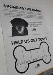 A poster with details on efforts to raise money for turf flooring is displayed Saturday, Jan. 11, at the Grey Face Rescue indoor dog park.