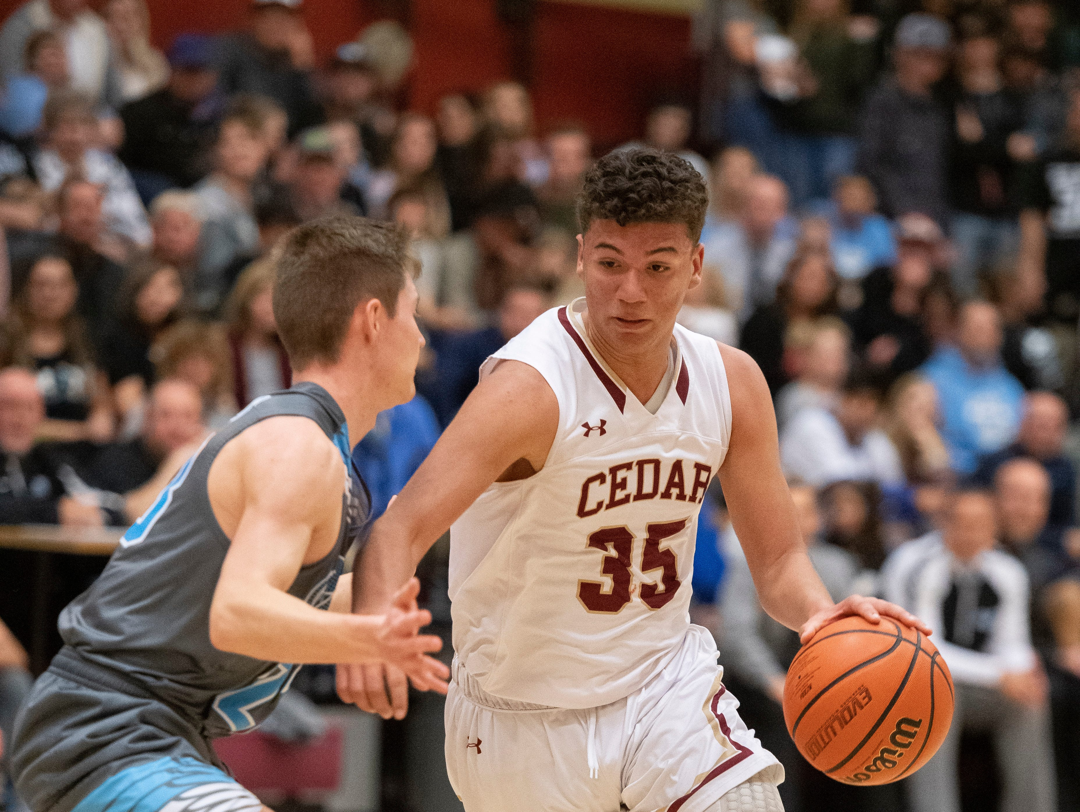 Cedar High School freshman Jorge Reyes (35) works the Canyon View defense at CHS Friday, January 11, 2019. Canyon View won, 61-56.