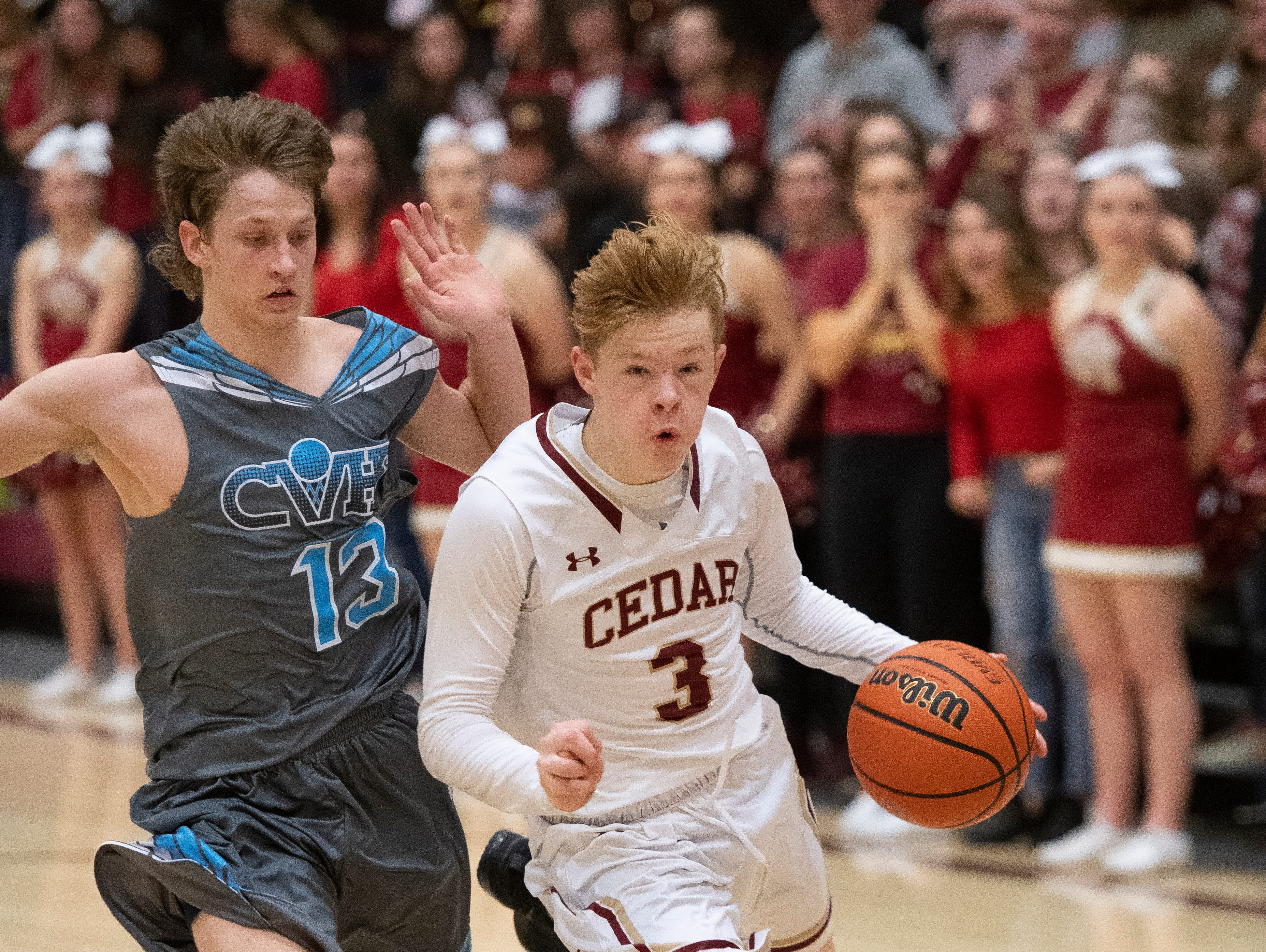 Cedar High School sophomore Gaige Savage (3) makes a go for the basket against Canyon View at CHS Friday, January 11, 2019. Canyon View won, 61-56.