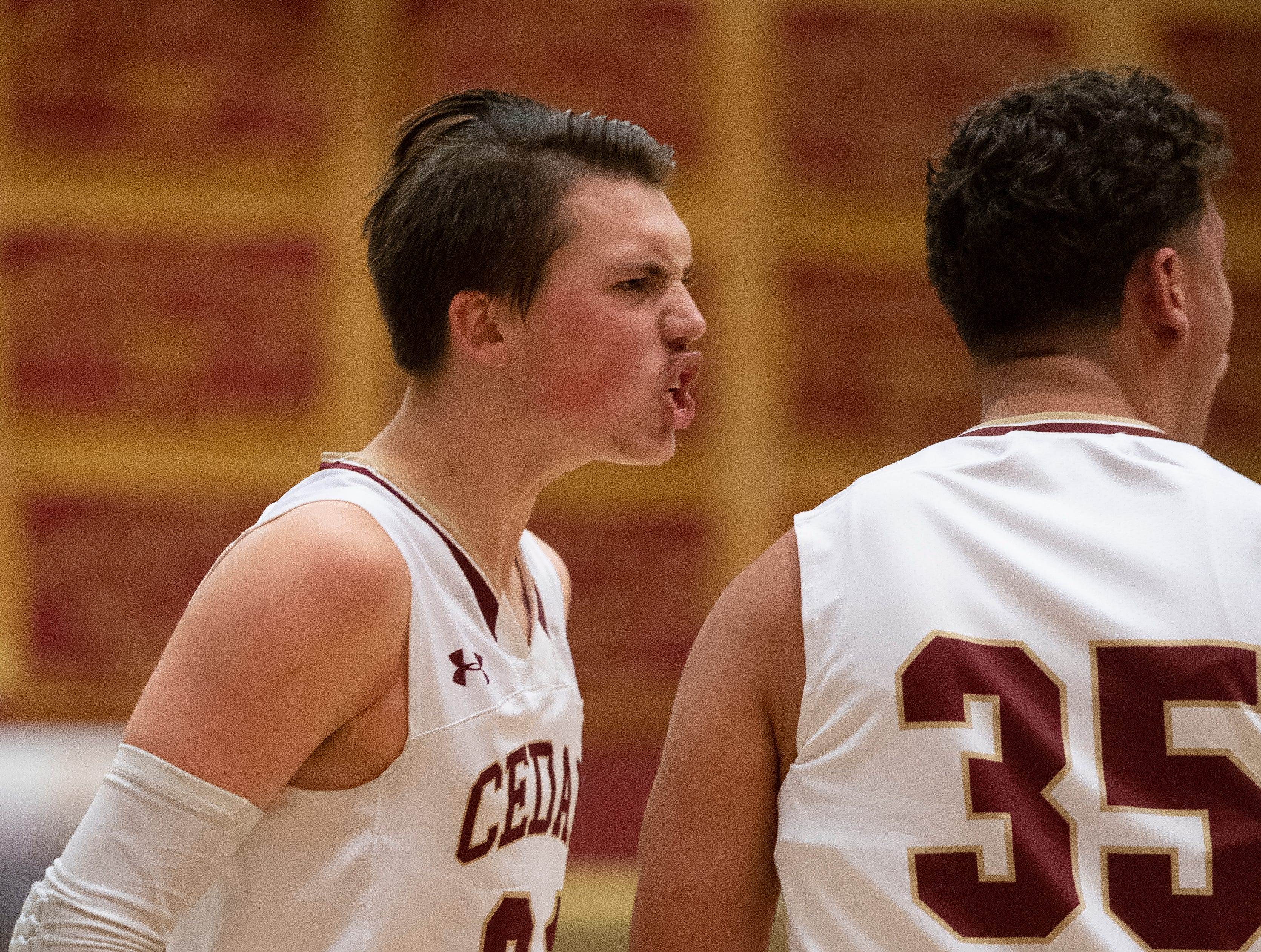 Cedar High senior Tanner Eyre (21) gets psyched about a score against Canyon View at a home game Jan. 11, 2019. Canyon View won 61-56.