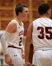 In this file photo, Cedar City's Tanner Eyre (left) gets psyched about a score. Cedar had its first region-game victory of the season Friday, a 62-46 win over Snow Canyon.
