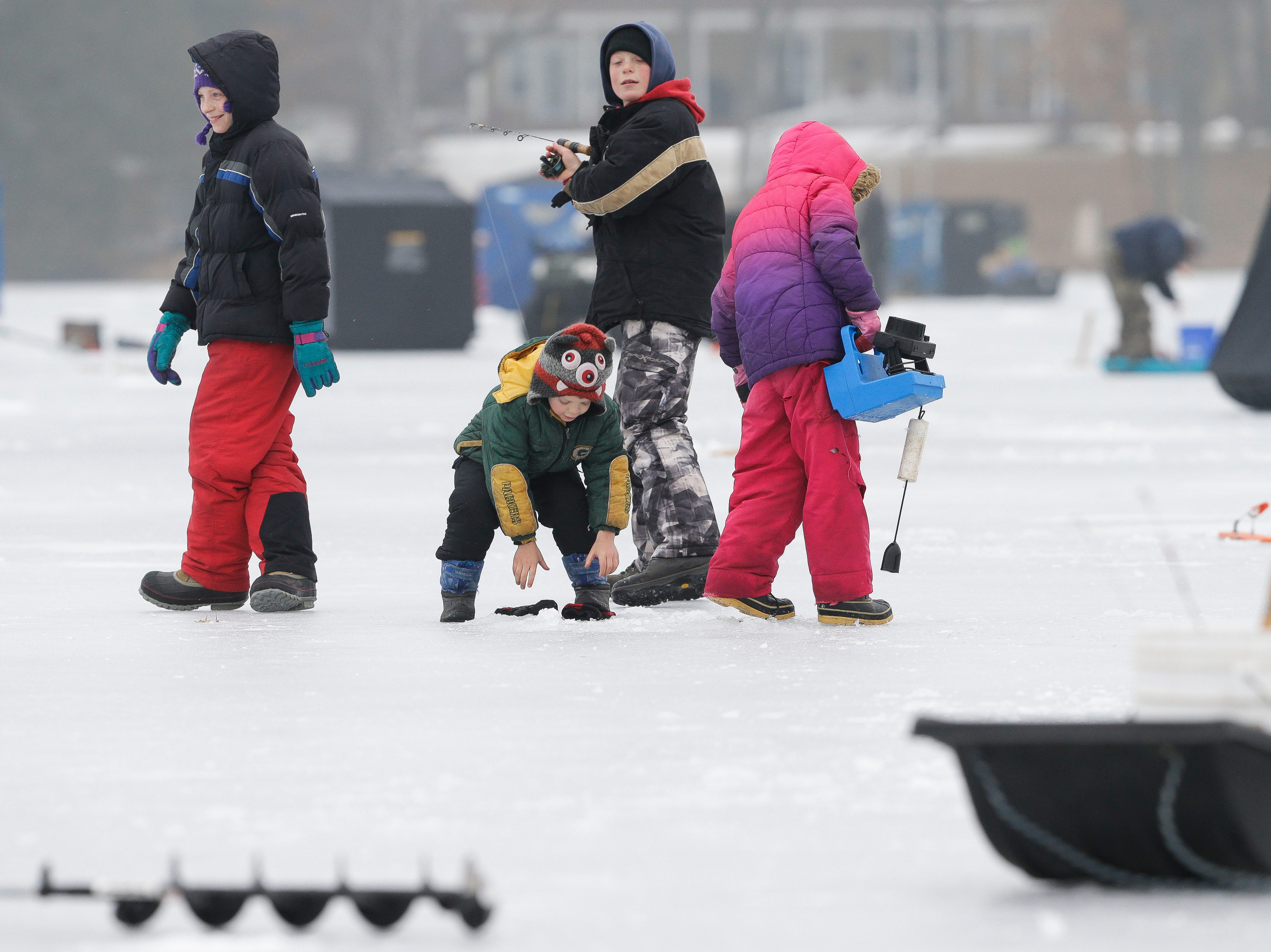 A group of young fishers pack up their gear on Saturday, January 12, 2019, during the Rosholt Blizzard Busters Fisheree at Lake Helen outside Rosholt, Wis.Tork Mason/USA TODAY NETWORK-Wisconsin
