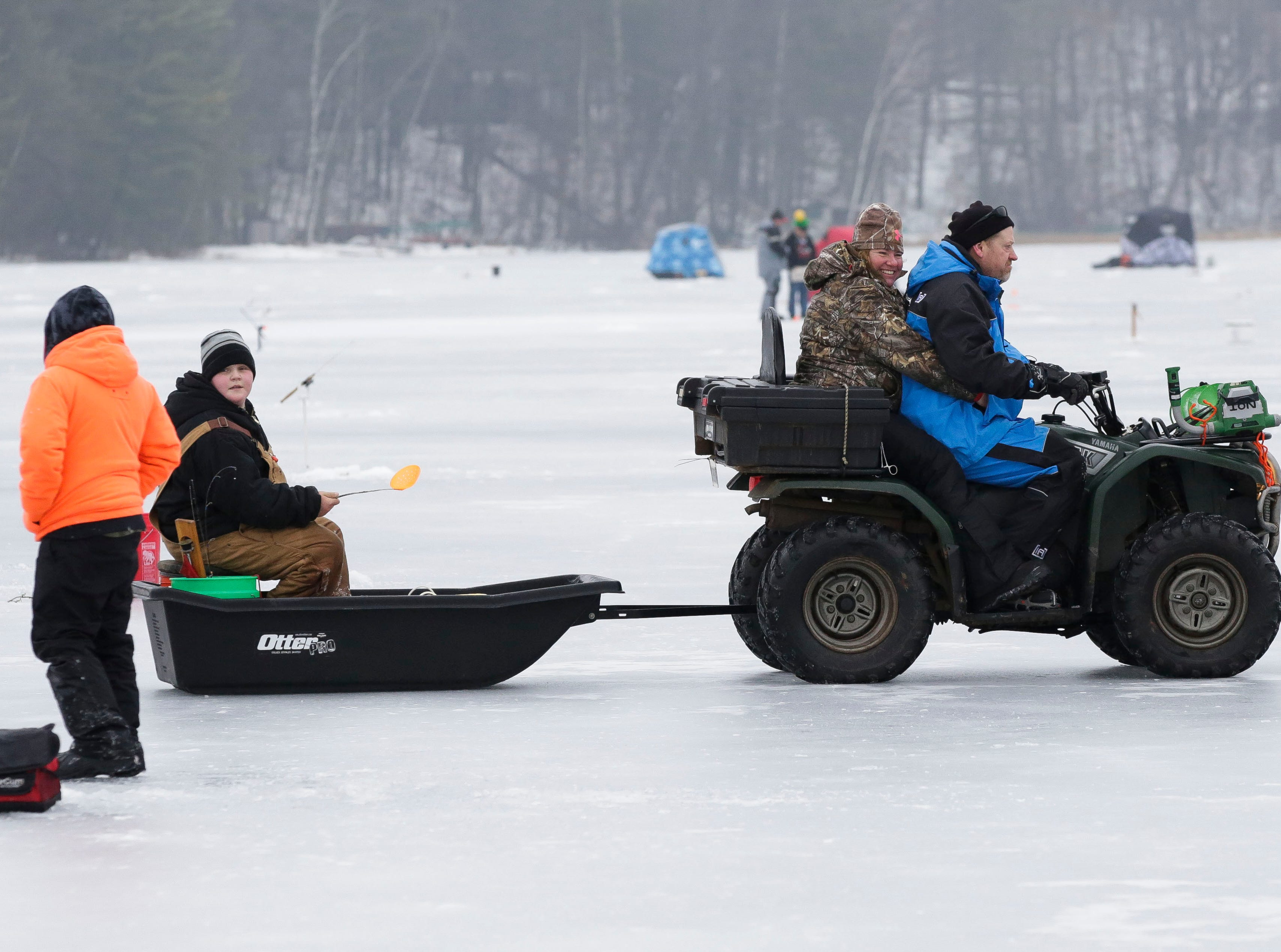 A group of ice fishers haul equipment to shore on Saturday, January 12, 2019, during the Rosholt Blizzard Busters Fisheree at Lake Helen outside Rosholt, Wis.Tork Mason/USA TODAY NETWORK-Wisconsin