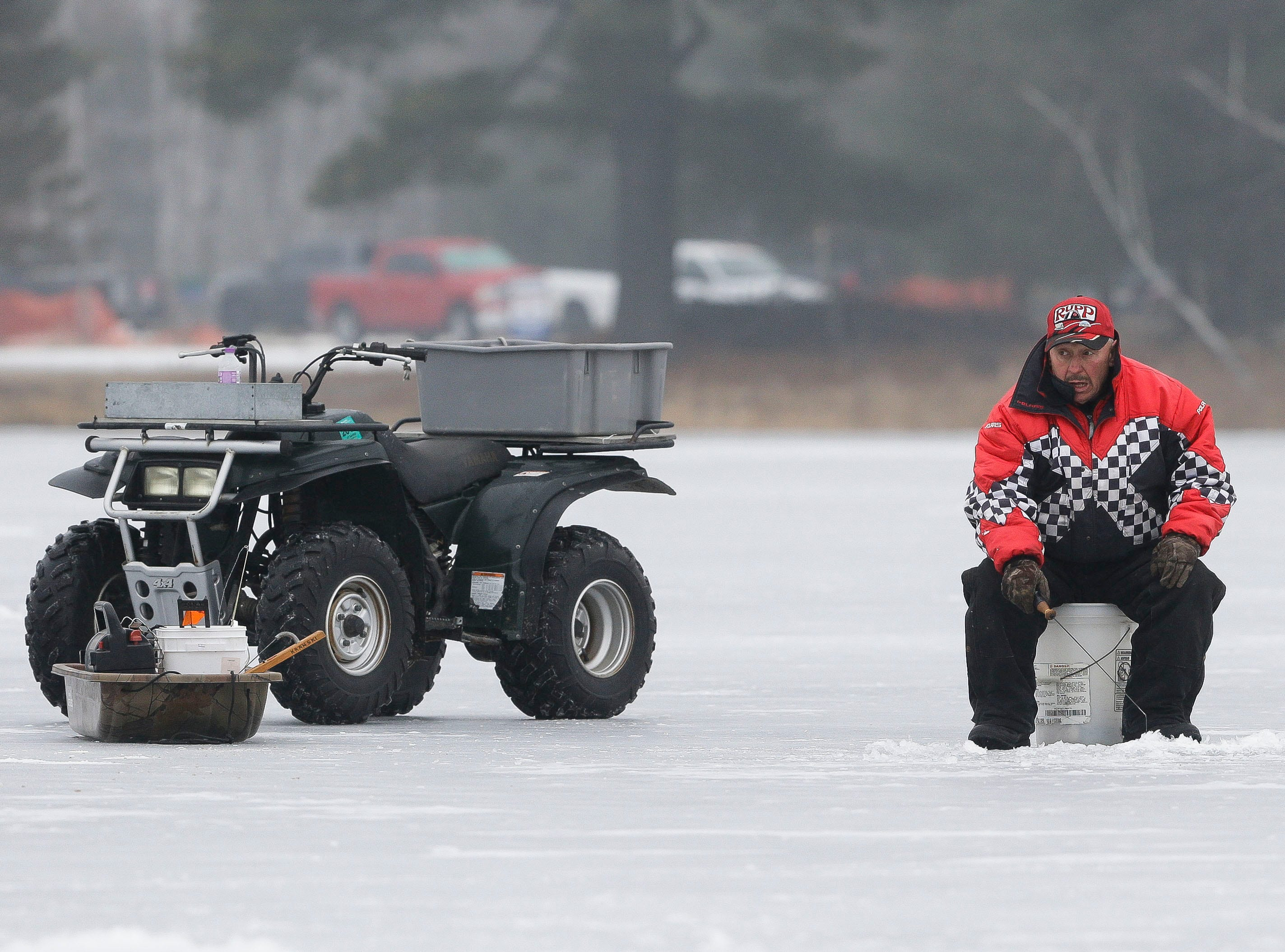 Dan Kranski mans his line on Saturday, January 12, 2019, during the Rosholt Blizzard Busters Fisheree at Lake Helen outside Rosholt, Wis.Tork Mason/USA TODAY NETWORK-Wisconsin
