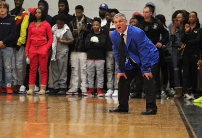 Godby boys basketball coach Andy Colville gets animated during a sold-out game at Rickards. The Cougars lost 67-57 on Jan. 11, 2019.