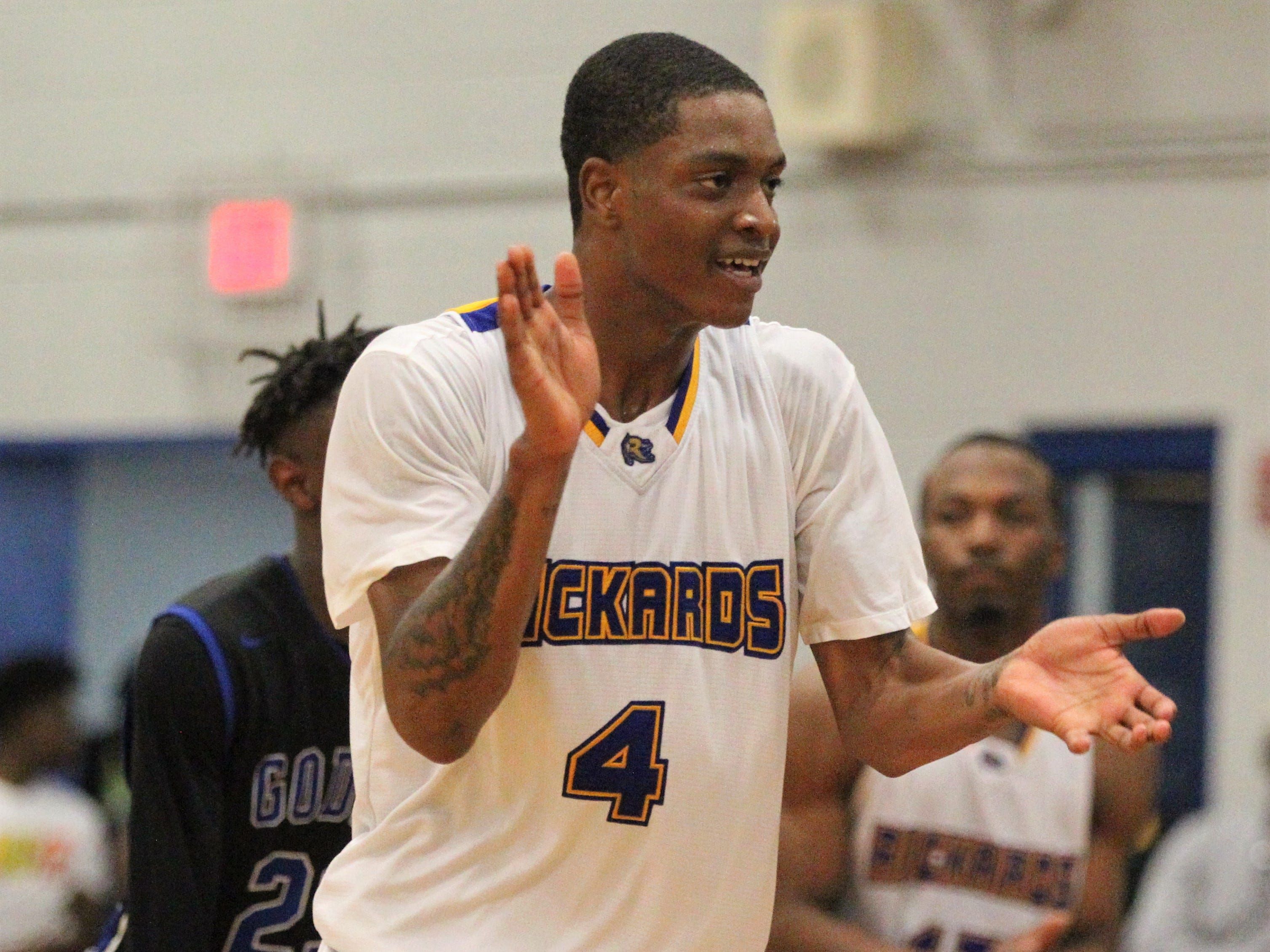 Rickards senior Phillip Russell celebrates after a 3-pointer. Russell scored 21 points and  beat Godby 67-57 at home on Jan. 11, 2019.