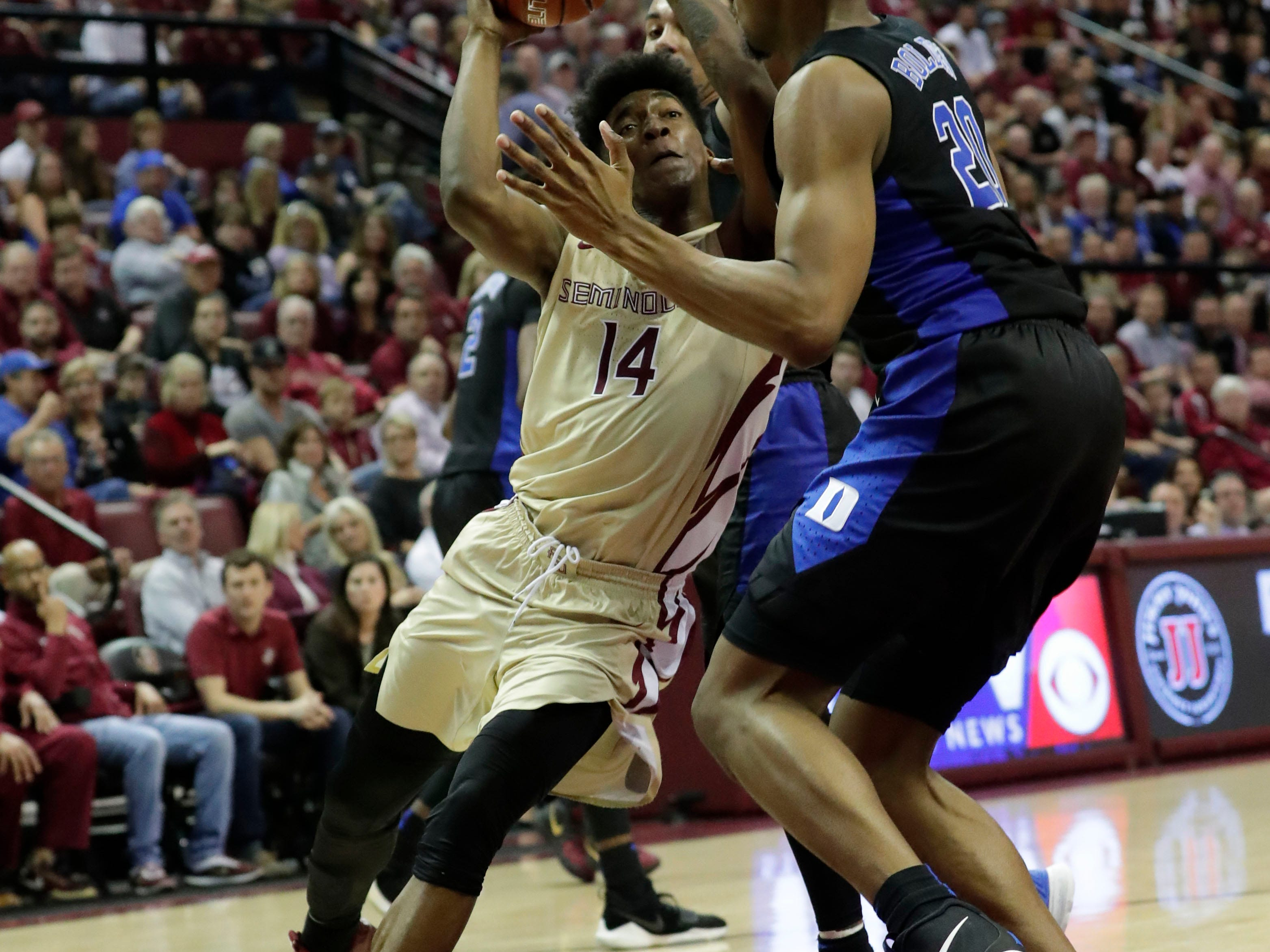 Florida State Seminoles guard Terance Mann (14) drives the ball in for a layup. Ranked 13 in the ACC, the Florida State Seminoles host the number 1 team, the Duke Blue Devils, at the Tucker Civic Center, Saturday, Jan. 12, 2019.