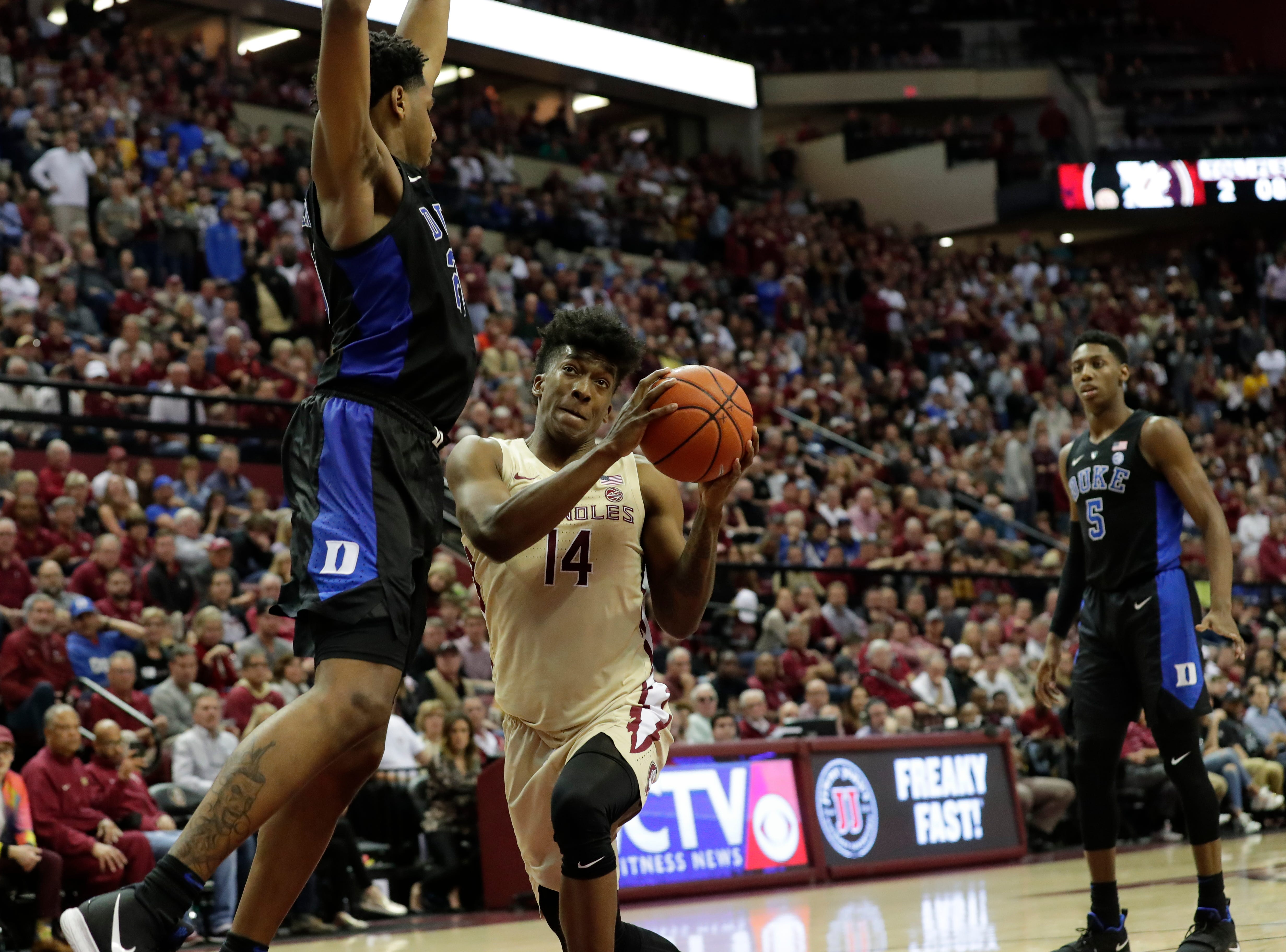 Florida State Seminoles guard Terance Mann (14) drives the ball to the hoop for a layup. Ranked 13 in the ACC, the Florida State Seminoles host the number 1 team, the Duke Blue Devils, at the Tucker Civic Center, Saturday, Jan. 12, 2019.