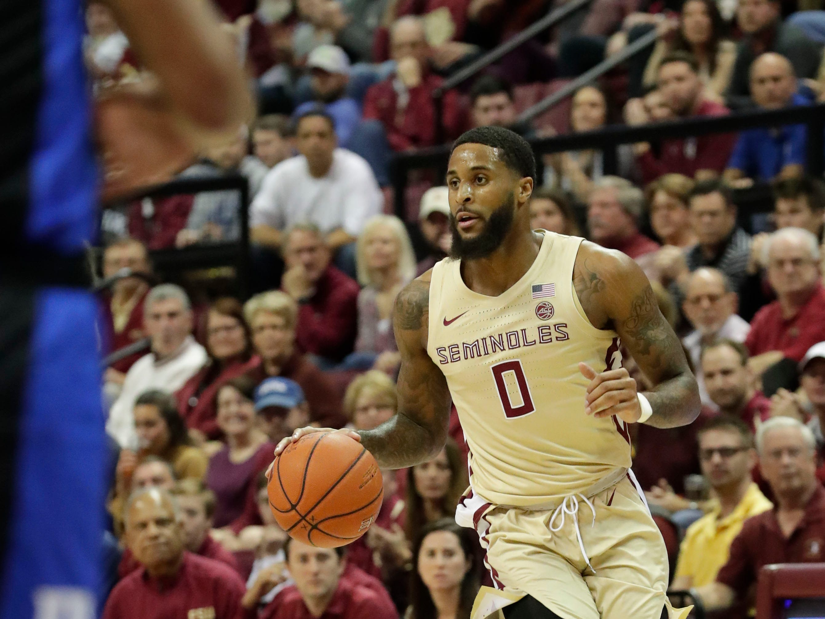 Florida State Seminoles forward Phil Cofer (0) drives the ball to the hoop to shoot for two. Ranked 13 in the ACC, the Florida State Seminoles host the number 1 team, the Duke Blue Devils, at the Tucker Civic Center, Saturday, Jan. 12, 2019.