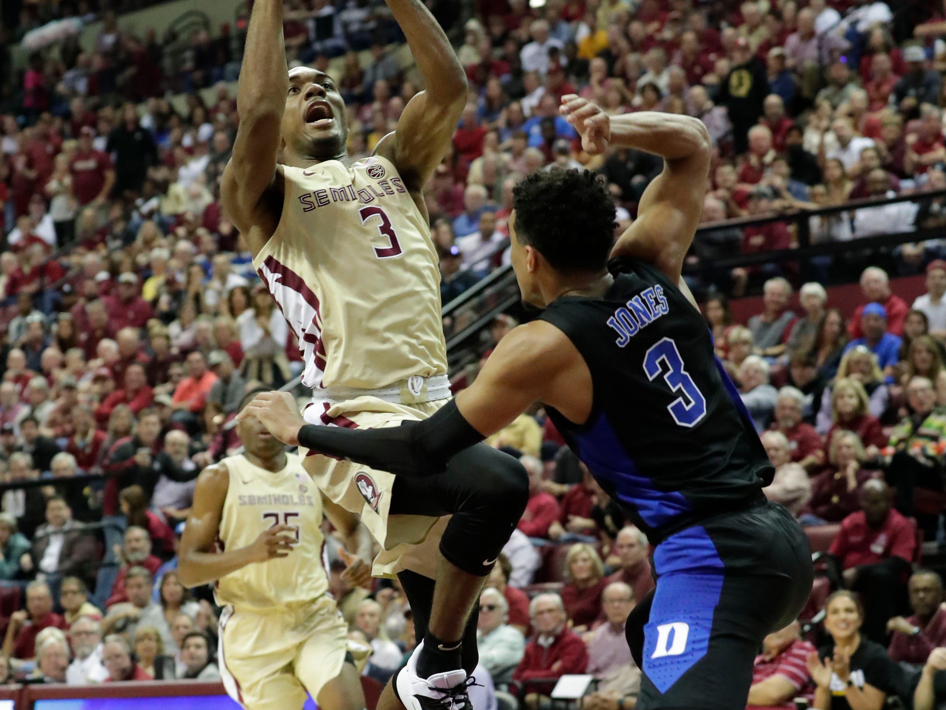 Florida State Seminoles guard Trent Forrest (3) drives the ball in for a layup while Duke Blue Devils guard Tre Jones (3) tries to stop him. Ranked 13 in the ACC, the Florida State Seminoles host the number 1 team, the Duke Blue Devils, at the Tucker Civic Center, Saturday, Jan. 12, 2019.