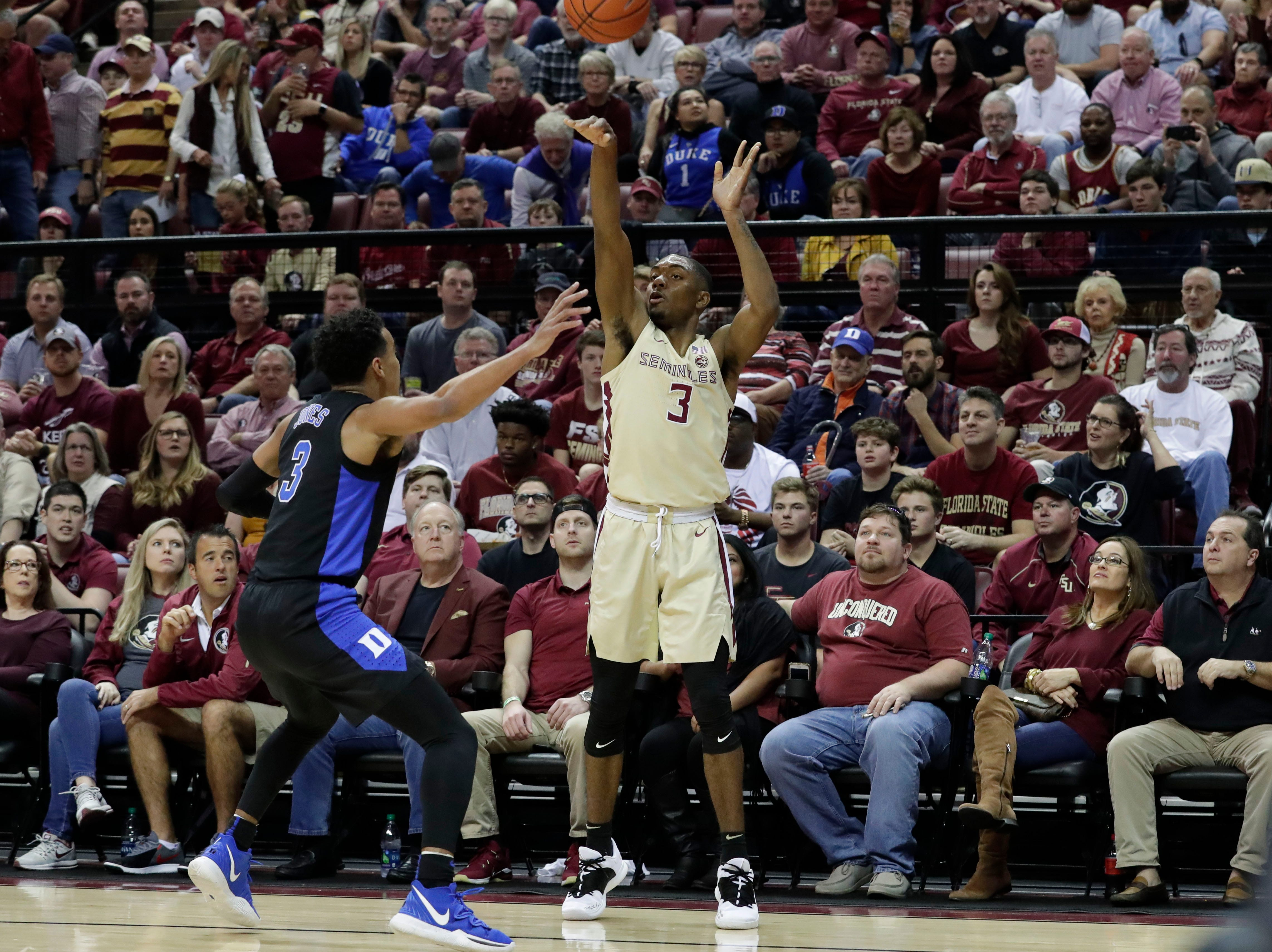 Florida State Seminoles guard Trent Forrest (3) shoots for three with Duke Blue Devils guard Tre Jones (3) trying to block the shot. Ranked 13 in the ACC, the Florida State Seminoles host the number 1 team, the Duke Blue Devils, at the Tucker Civic Center, Saturday, Jan. 12, 2019.