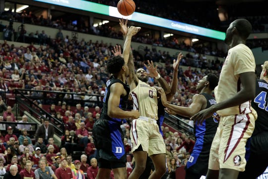 Florida State Seminoles forward Phil Cofer (0) shoots over multiple defenders. Ranked 13 in the ACC, the Florida State Seminoles host the number 1 team, the Duke Blue Devils, at the Tucker Civic Center, Saturday, Jan. 12, 2019.