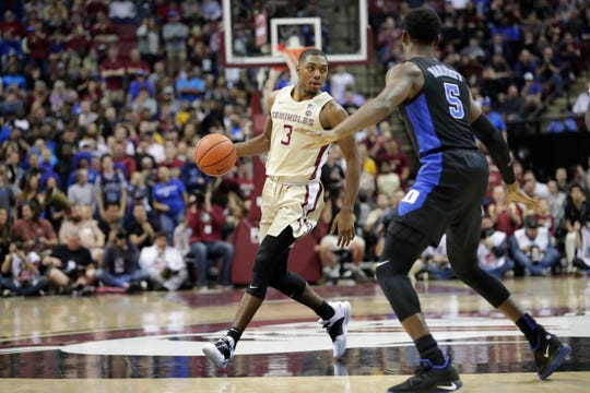 Florida State Seminoles guard Trent Forrest (3) looks for an open play to pass to while Florida State Seminoles guard PJ Savoy (5) tries to block the pass. Ranked 13 in the ACC, the Florida State Seminoles host the number 1 team, the Duke Blue Devils, at the Tucker Civic Center, Saturday, Jan. 12, 2019.