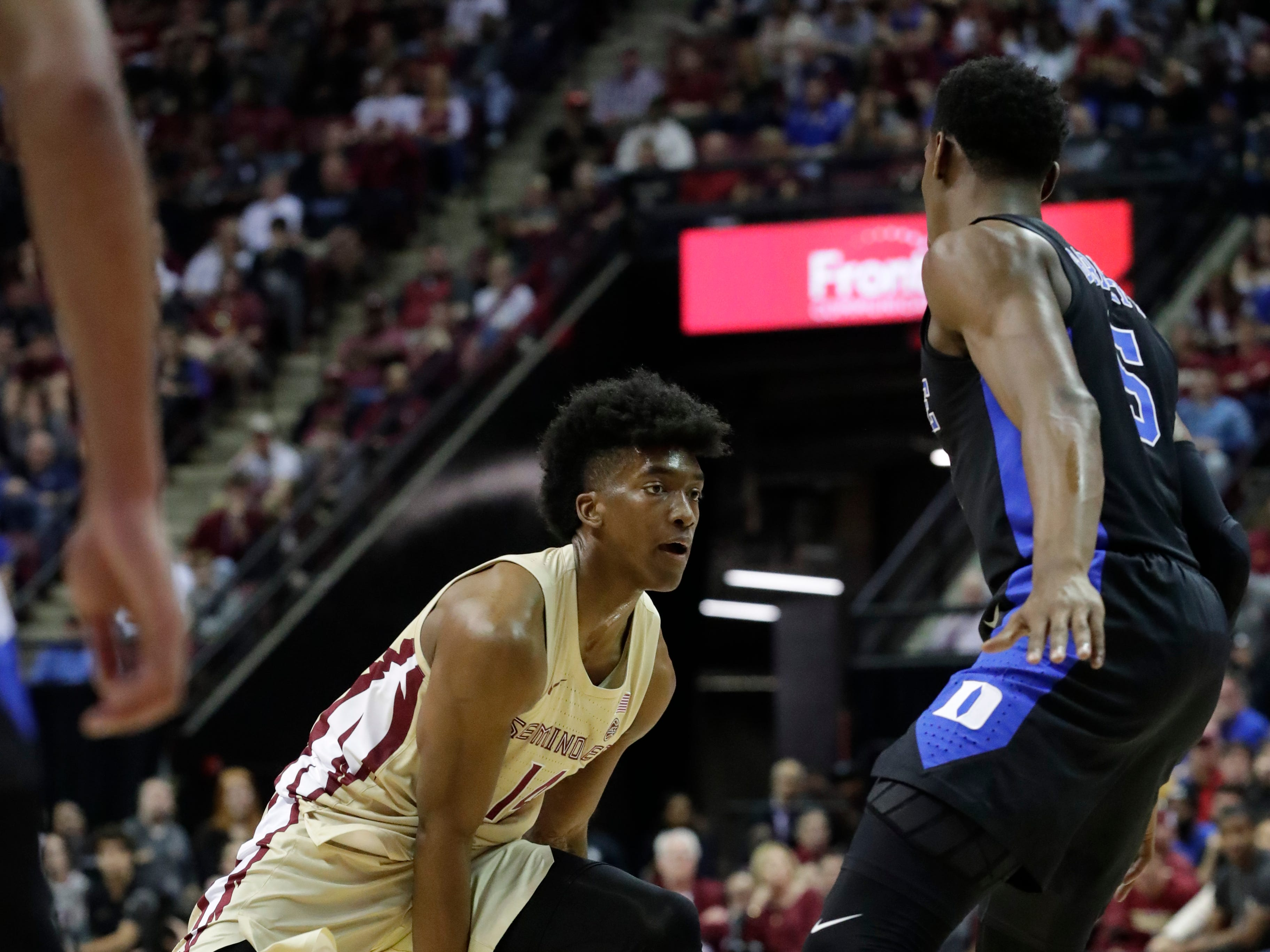 Florida State Seminoles guard Terance Mann (14) dribbles the ball between his legs while looking for a teammate to pass to. Ranked 13 in the ACC, the Florida State Seminoles host the number 1 team, the Duke Blue Devils, at the Tucker Civic Center, Saturday, Jan. 12, 2019.