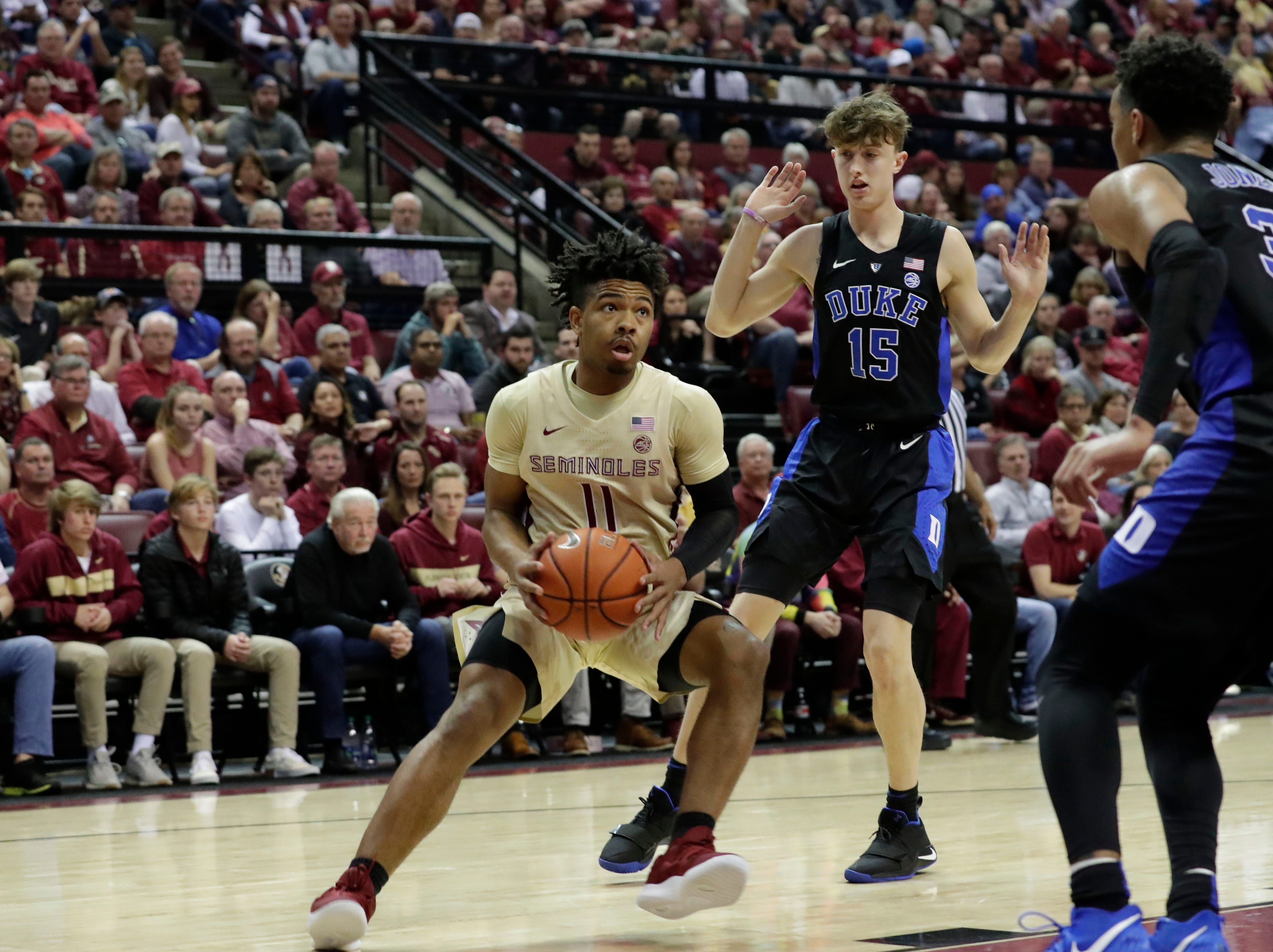 Florida State Seminoles guard David Nichols (11) looks towards the hoop for an opportunity to shoot. Ranked 13 in the ACC, the Florida State Seminoles host the number 1 team, the Duke Blue Devils, at the Tucker Civic Center, Saturday, Jan. 12, 2019.
