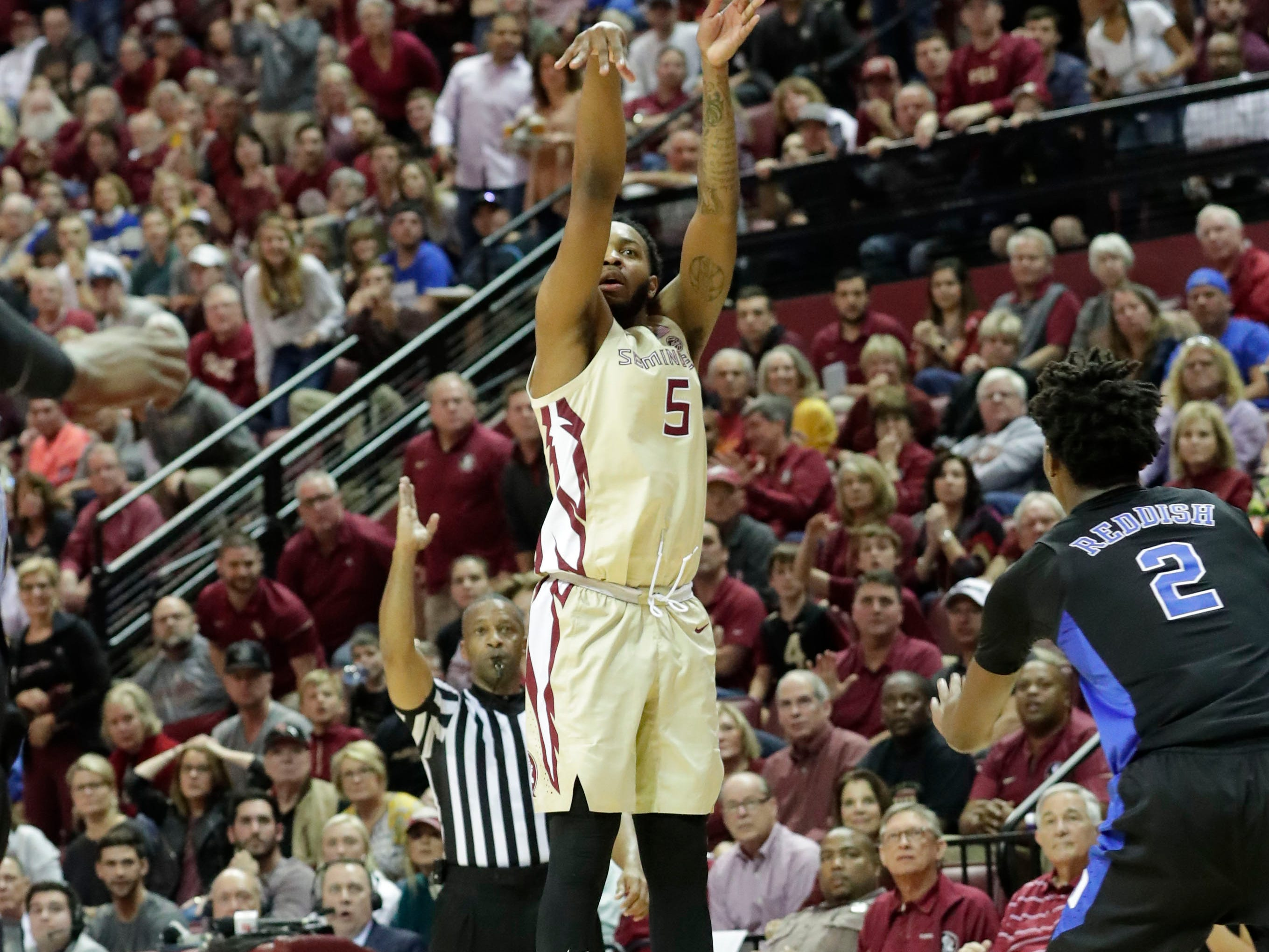 Florida State Seminoles guard PJ Savoy (5) shoots for three. Ranked 13 in the ACC, the Florida State Seminoles host the number 1 team, the Duke Blue Devils, at the Tucker Civic Center, Saturday, Jan. 12, 2019.