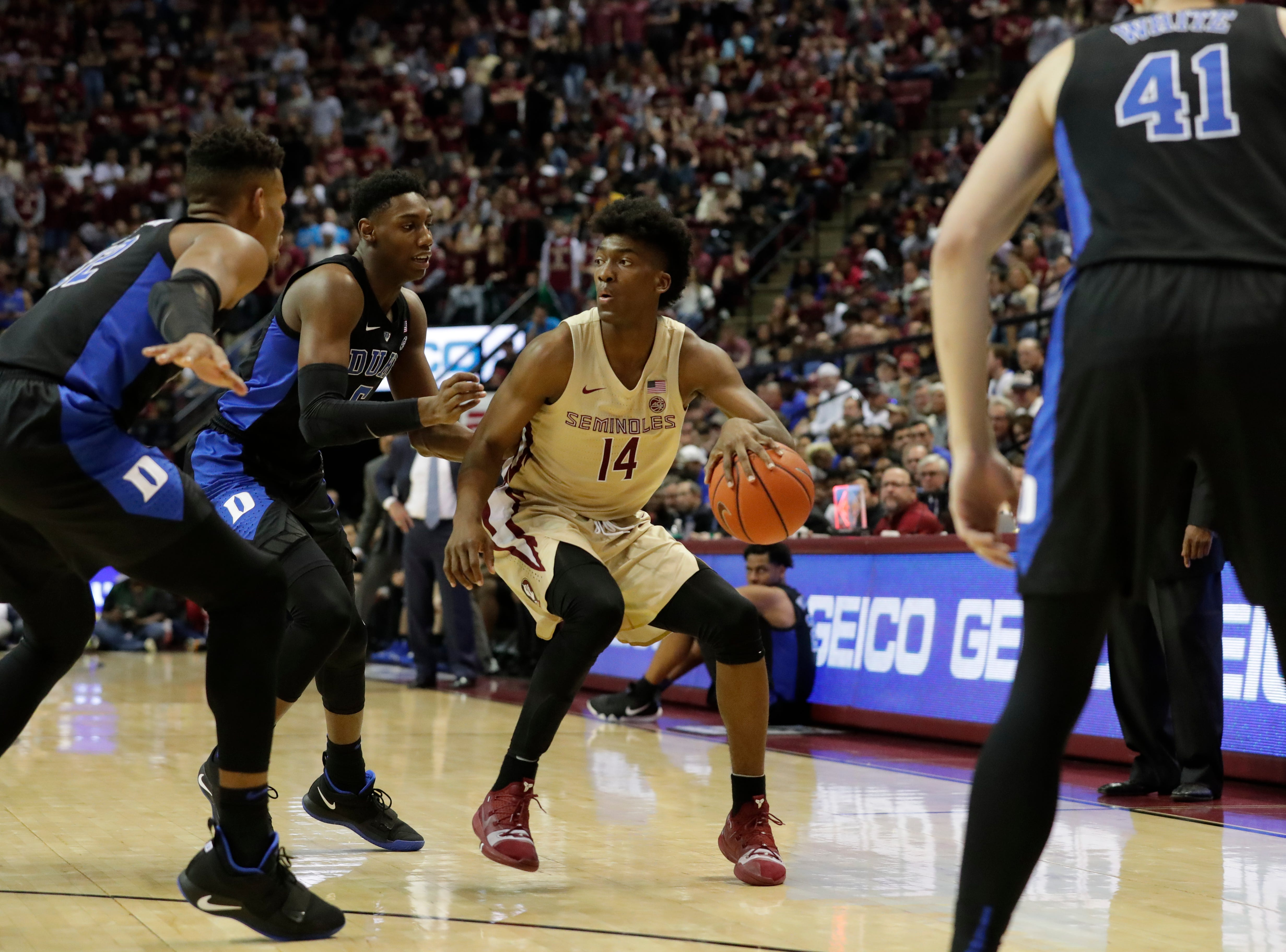 Florida State Seminoles guard Terance Mann (14) looks for assistance from a teammate as multiple defenders begin to surround him. Ranked 13 in the ACC, the Florida State Seminoles host the number 1 team, the Duke Blue Devils, at the Tucker Civic Center, Saturday, Jan. 12, 2019.