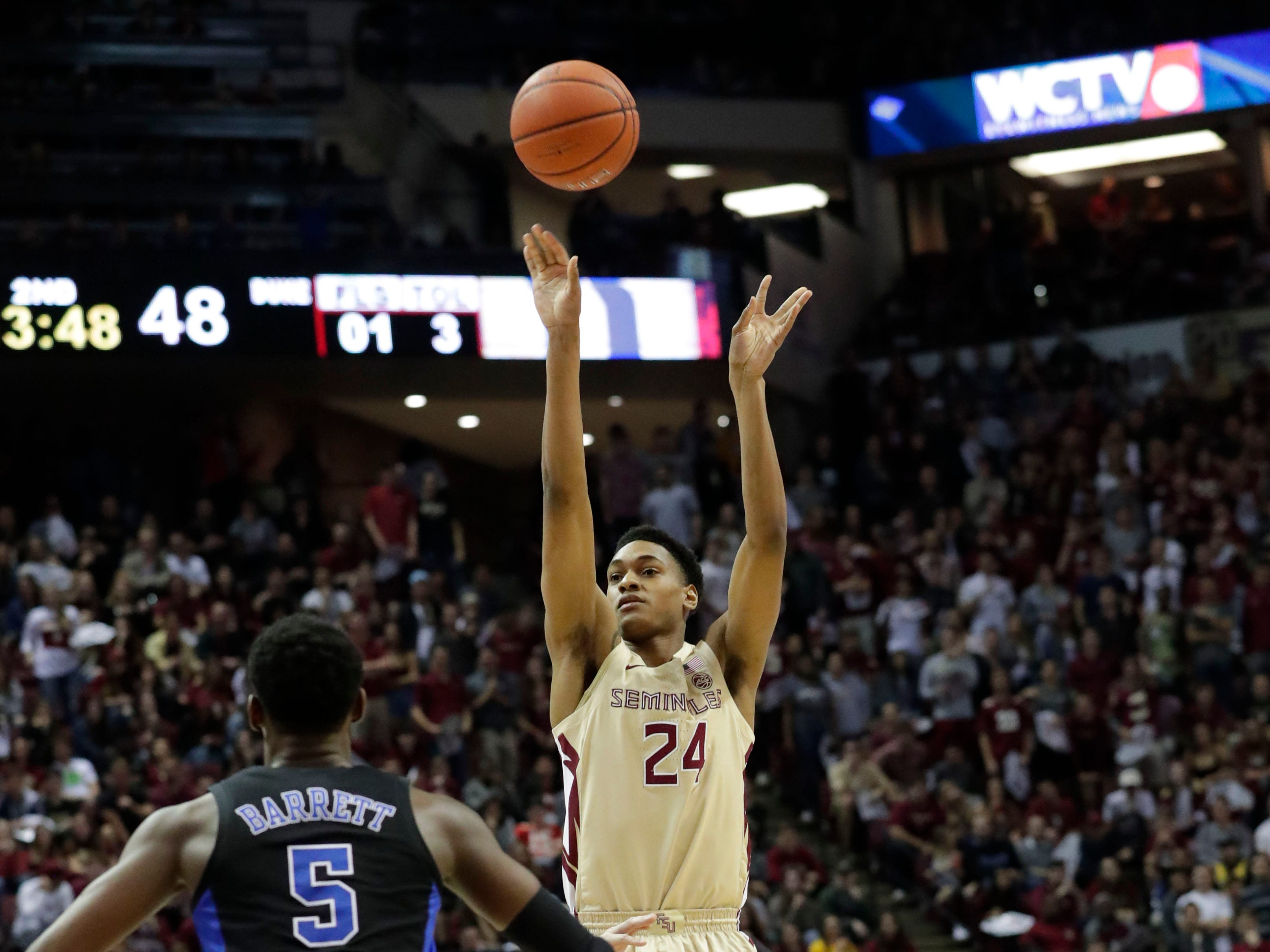 Florida State Seminoles guard Devin Vassell (24) shoots for three. Ranked 13 in the ACC, the Florida State Seminoles host the number 1 team, the Duke Blue Devils, at the Tucker Civic Center, Saturday, Jan. 12, 2019.