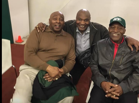 FAMU legendary head coach Billy Joe shares a moment with former New York Jets teammates Randy Beverly (left) and Cornell Gordon. The players gathered in New York City this fall to celebrate the 50th anniversary of their Super Bowl championship season.