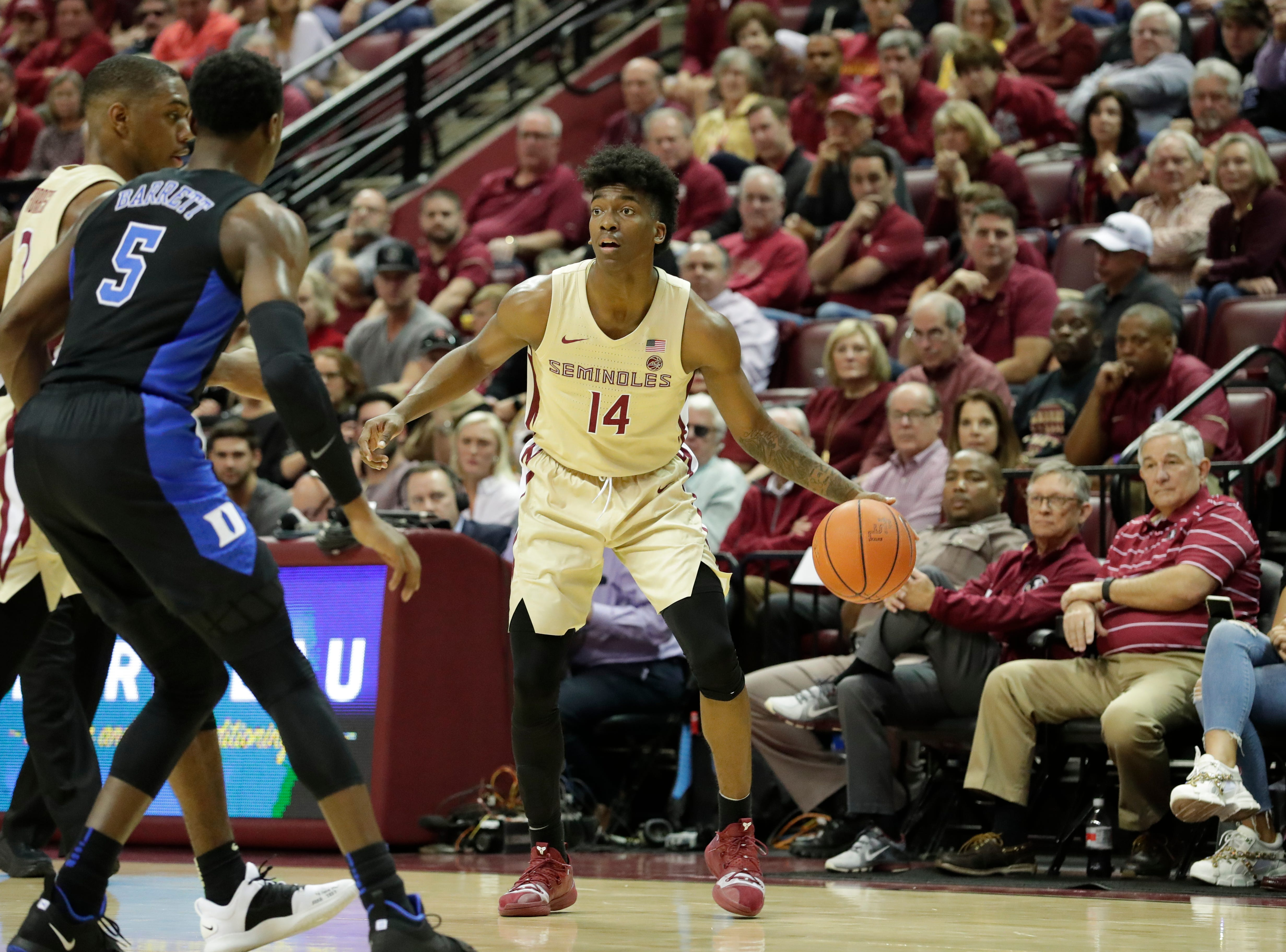 Florida State Seminoles guard Terance Mann (14) looks to pass to an open teammate. Ranked 13 in the ACC, the Florida State Seminoles host the number 1 team, the Duke Blue Devils, at the Tucker Civic Center, Saturday, Jan. 12, 2019.