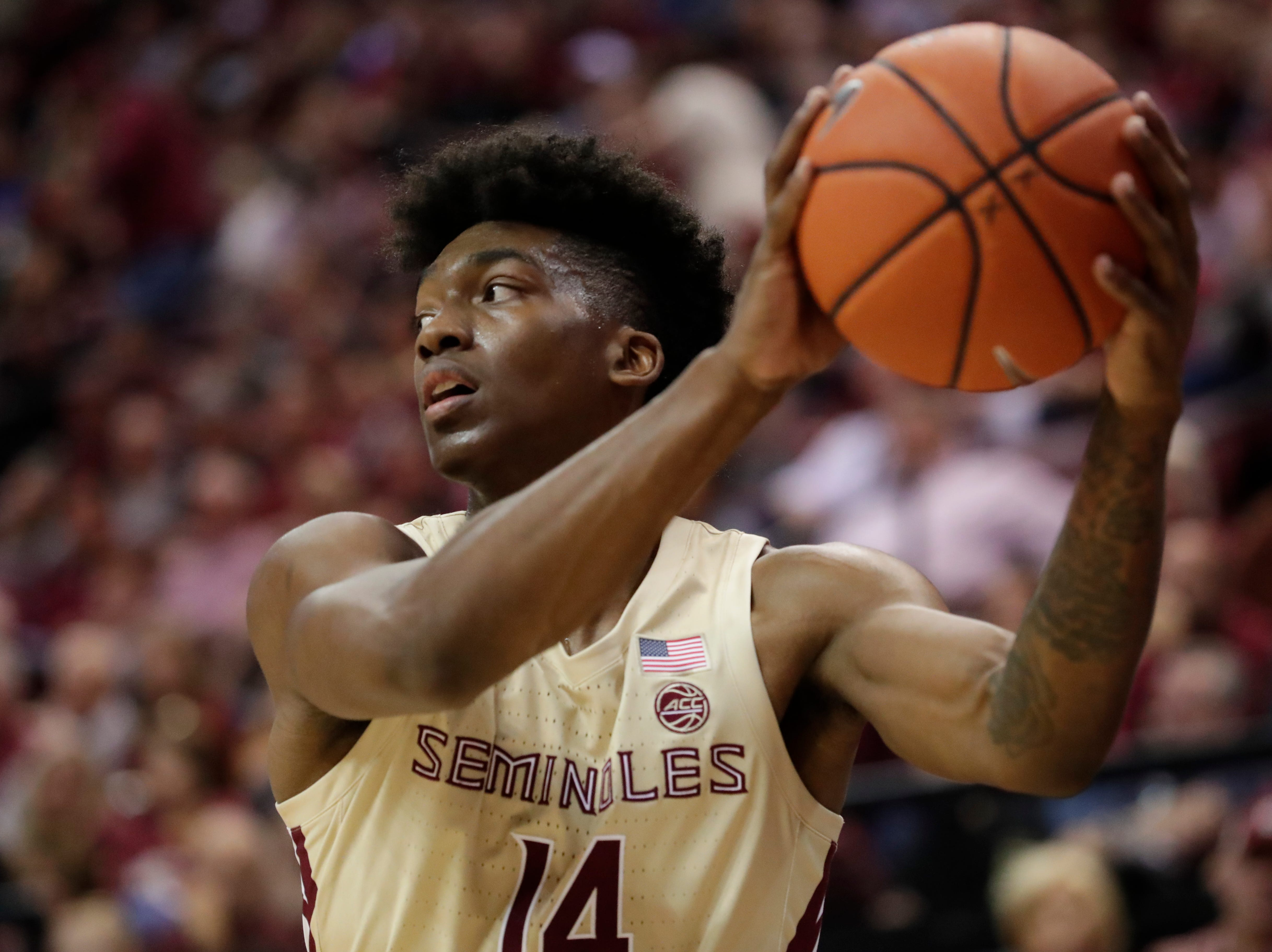 Florida State Seminoles guard Terance Mann (14) keeps the ball away from his defender while looking for an open teammate. Ranked 13 in the ACC, the Florida State Seminoles host the number 1 team, the Duke Blue Devils, at the Tucker Civic Center, Saturday, Jan. 12, 2019.