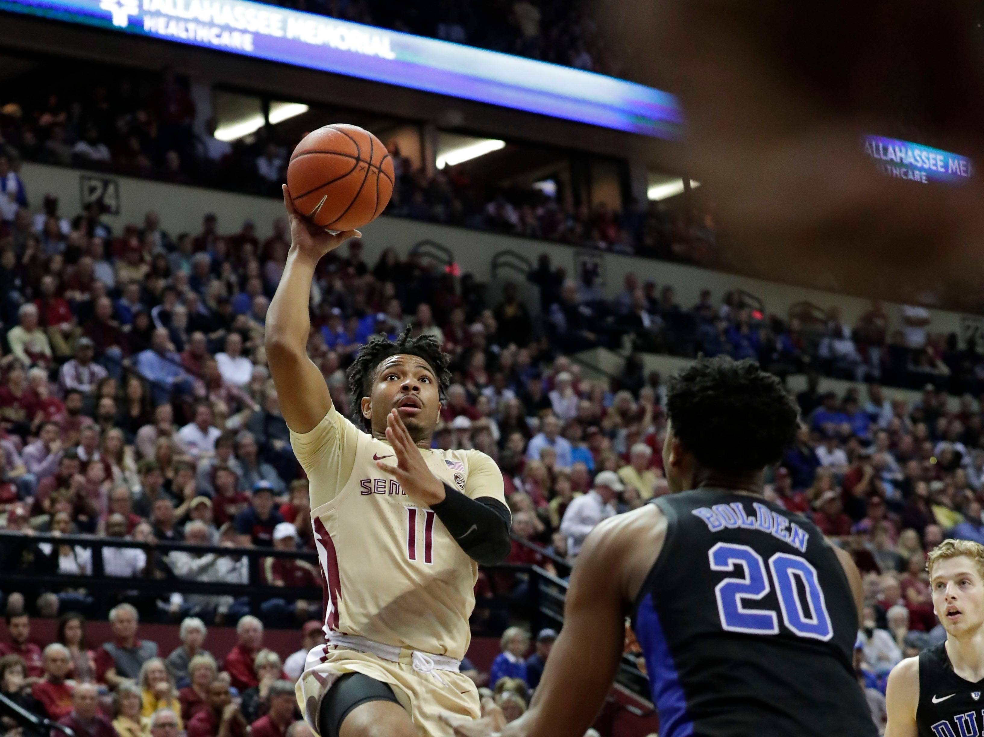 Florida State Seminoles guard David Nichols (11) shoots for two over Duke Blue Devils center Marques Bolden (20). Ranked 13 in the ACC, the Florida State Seminoles host the number 1 team, the Duke Blue Devils, at the Tucker Civic Center, Saturday, Jan. 12, 2019.
