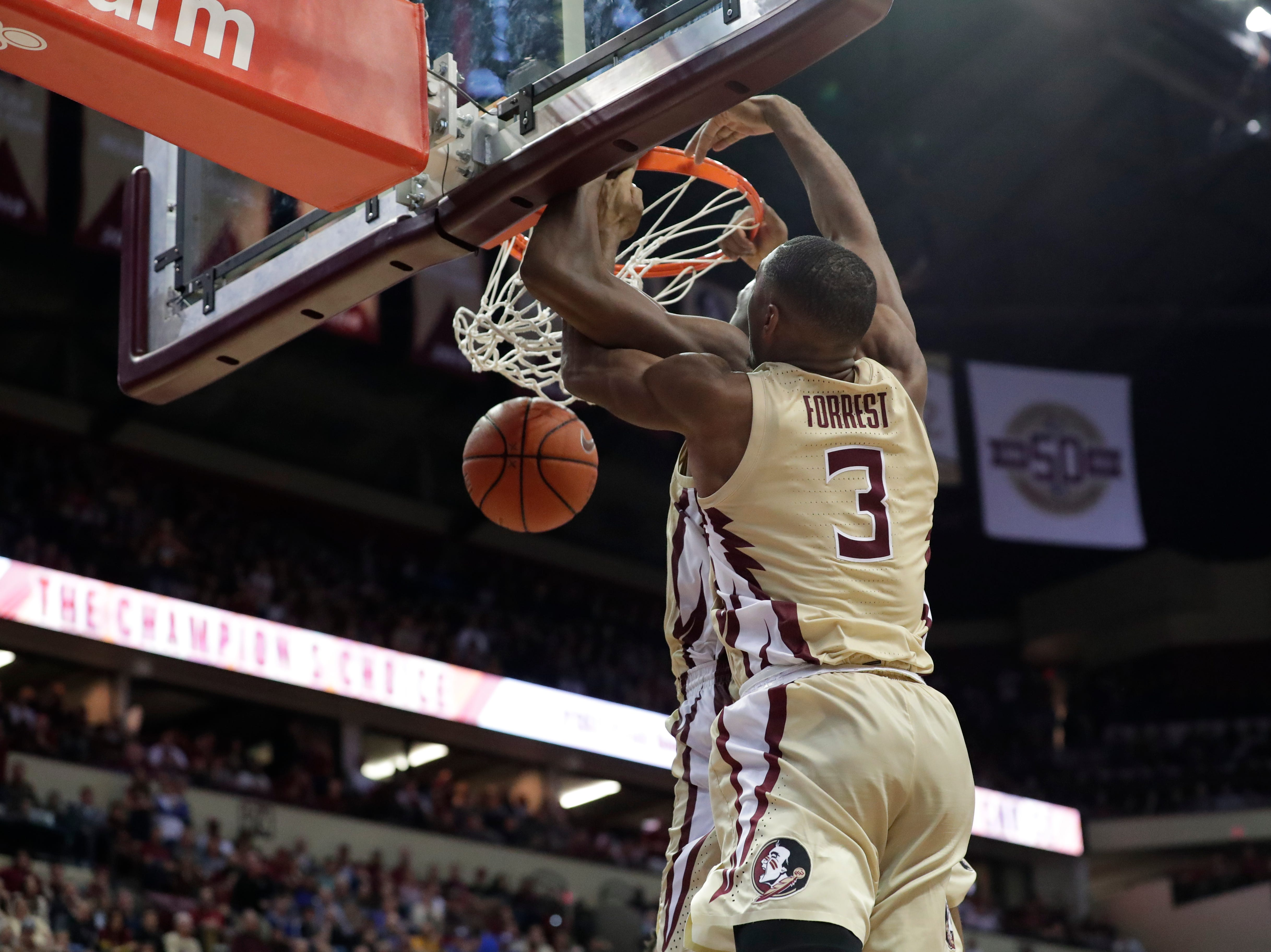 Florida State Seminoles guard Trent Forrest (3) and Florida State Seminoles forward Mfiondu Kabengele (25) go up to dunk the ball together. Ranked 13 in the ACC, the Florida State Seminoles host the number 1 team, the Duke Blue Devils, at the Tucker Civic Center, Saturday, Jan. 12, 2019.