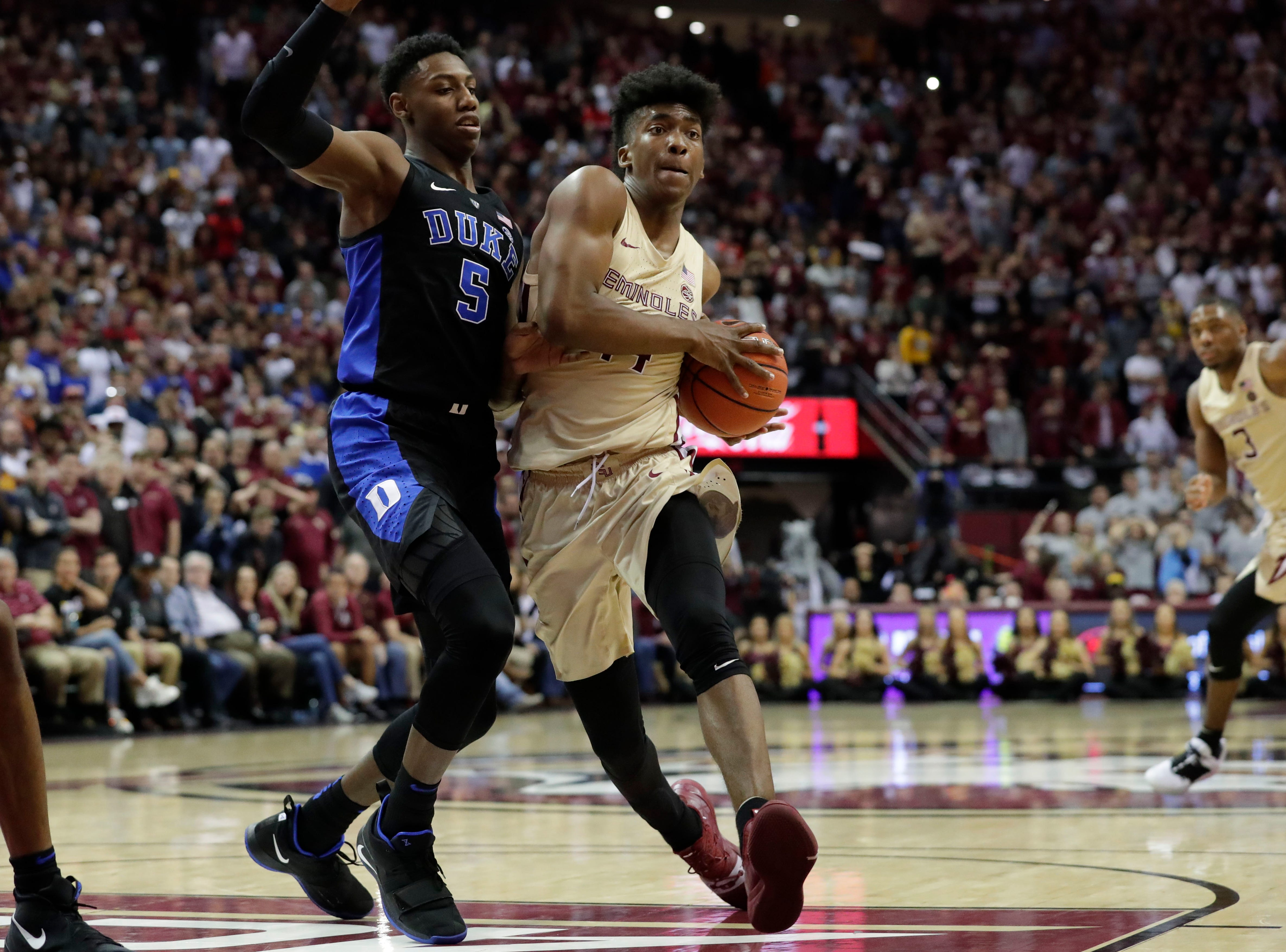 Florida State Seminoles guard Terance Mann (14) drives the ball to the hoop right past Duke Blue Devils forward RJ Barrett (5). Ranked 13 in the ACC, the Florida State Seminoles host the number 1 team, the Duke Blue Devils, at the Tucker Civic Center, Saturday, Jan. 12, 2019.