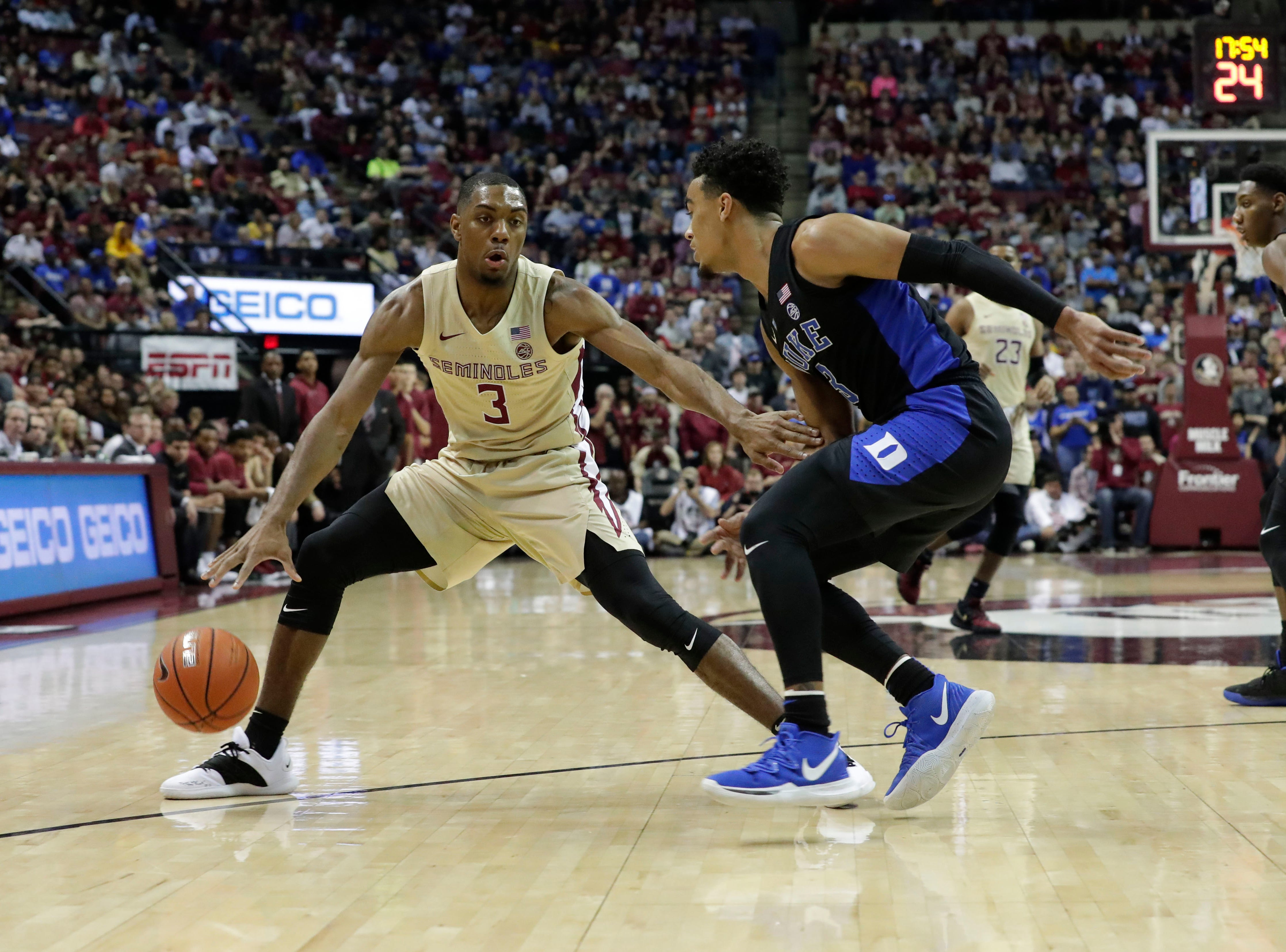 Florida State Seminoles guard Trent Forrest (3) tries to fight off his defender as he drives the ball to the hoop. Ranked 13 in the ACC, the Florida State Seminoles host the number 1 team, the Duke Blue Devils, at the Tucker Civic Center, Saturday, Jan. 12, 2019.