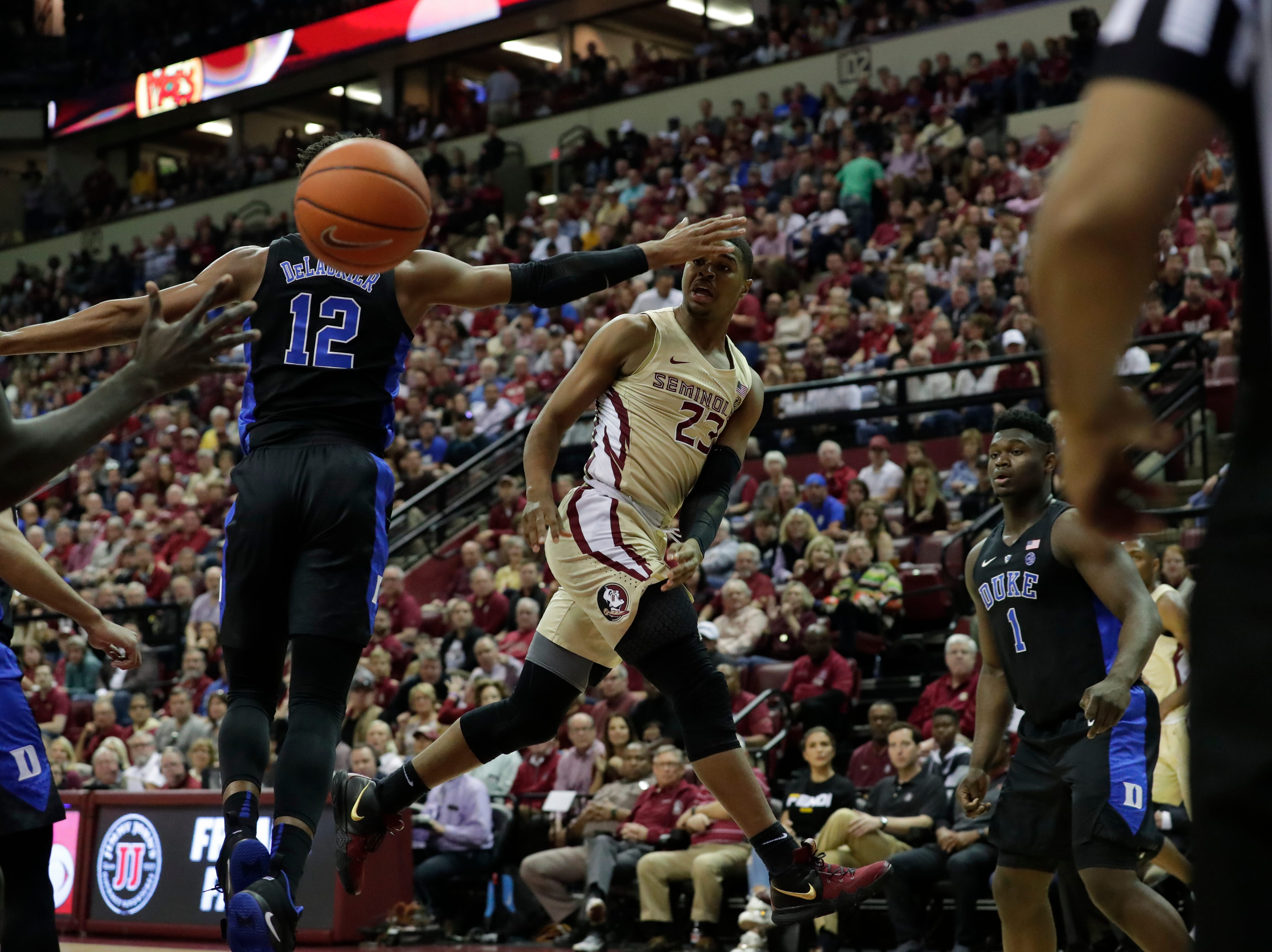 Florida State Seminoles guard M.J. Walker (23) passes around Duke Blue Devils forward Javin DeLaurier (12) to an open teammate. Ranked 13 in the ACC, the Florida State Seminoles host the number 1 team, the Duke Blue Devils, at the Tucker Civic Center, Saturday, Jan. 12, 2019.