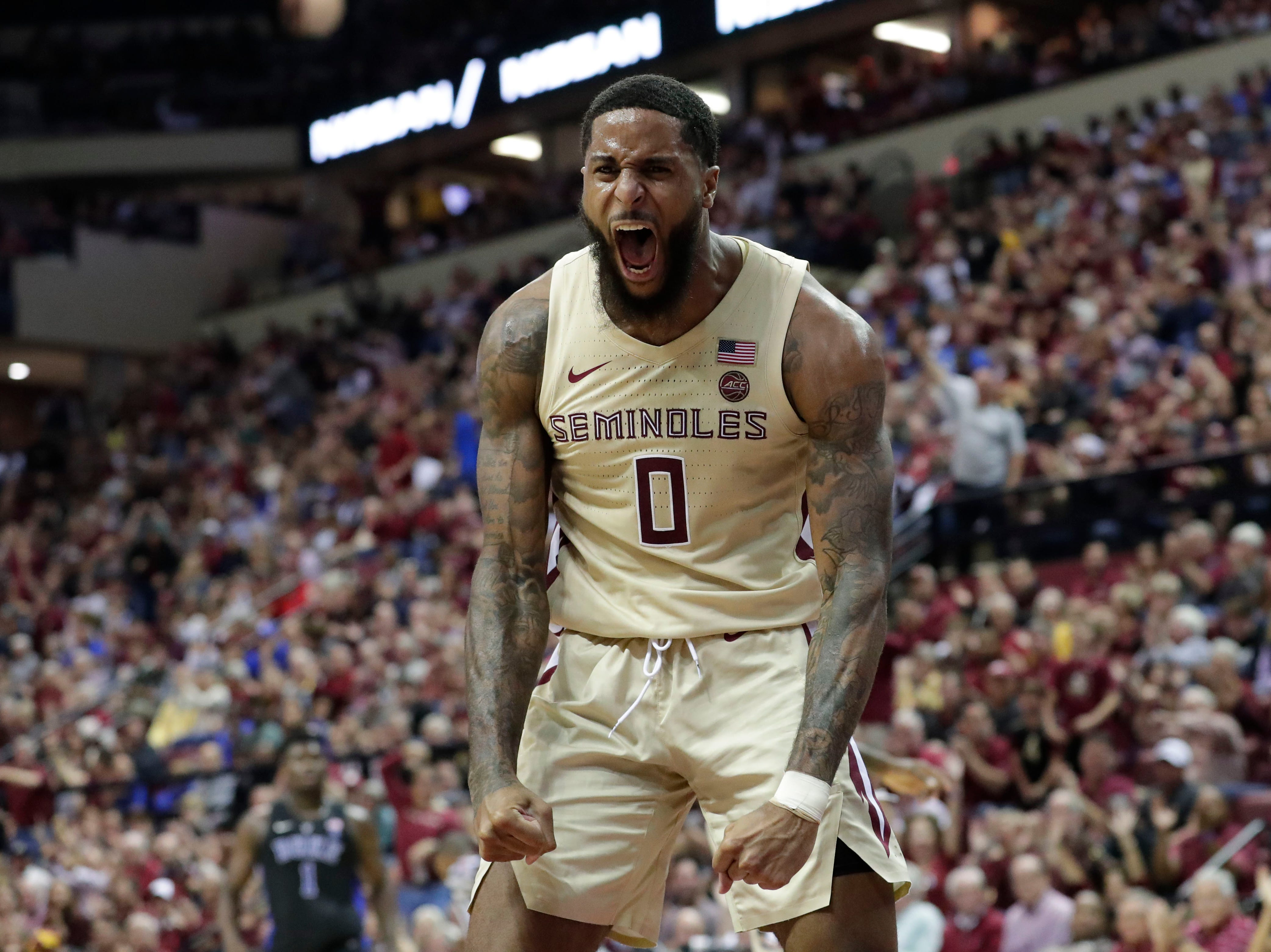 Ranked 13 in the ACC, the Florida State Seminoles host the number 1 team, the Duke Blue Devils, at the Tucker Civic Center, Saturday, Jan. 12, 2019. Florida State Seminoles forward Phil Cofer (0) celebrates a dunk.