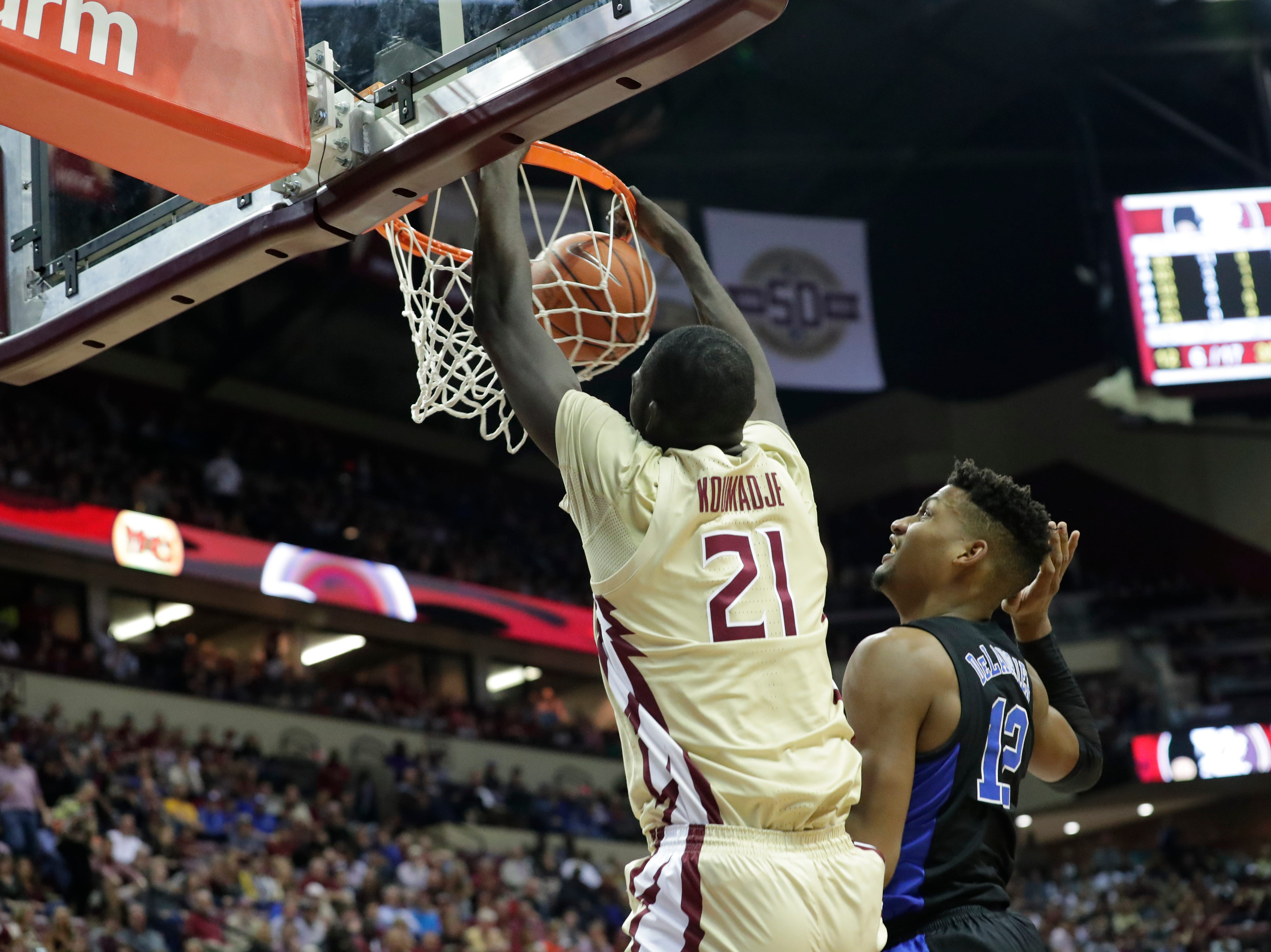 Florida State Seminoles center Christ Koumadje (21) gets to the hoop before Duke Blue Devils forward Javin DeLaurier (12) can stop him. Ranked 13 in the ACC, the Florida State Seminoles host the number 1 team, the Duke Blue Devils, at the Tucker Civic Center, Saturday, Jan. 12, 2019.