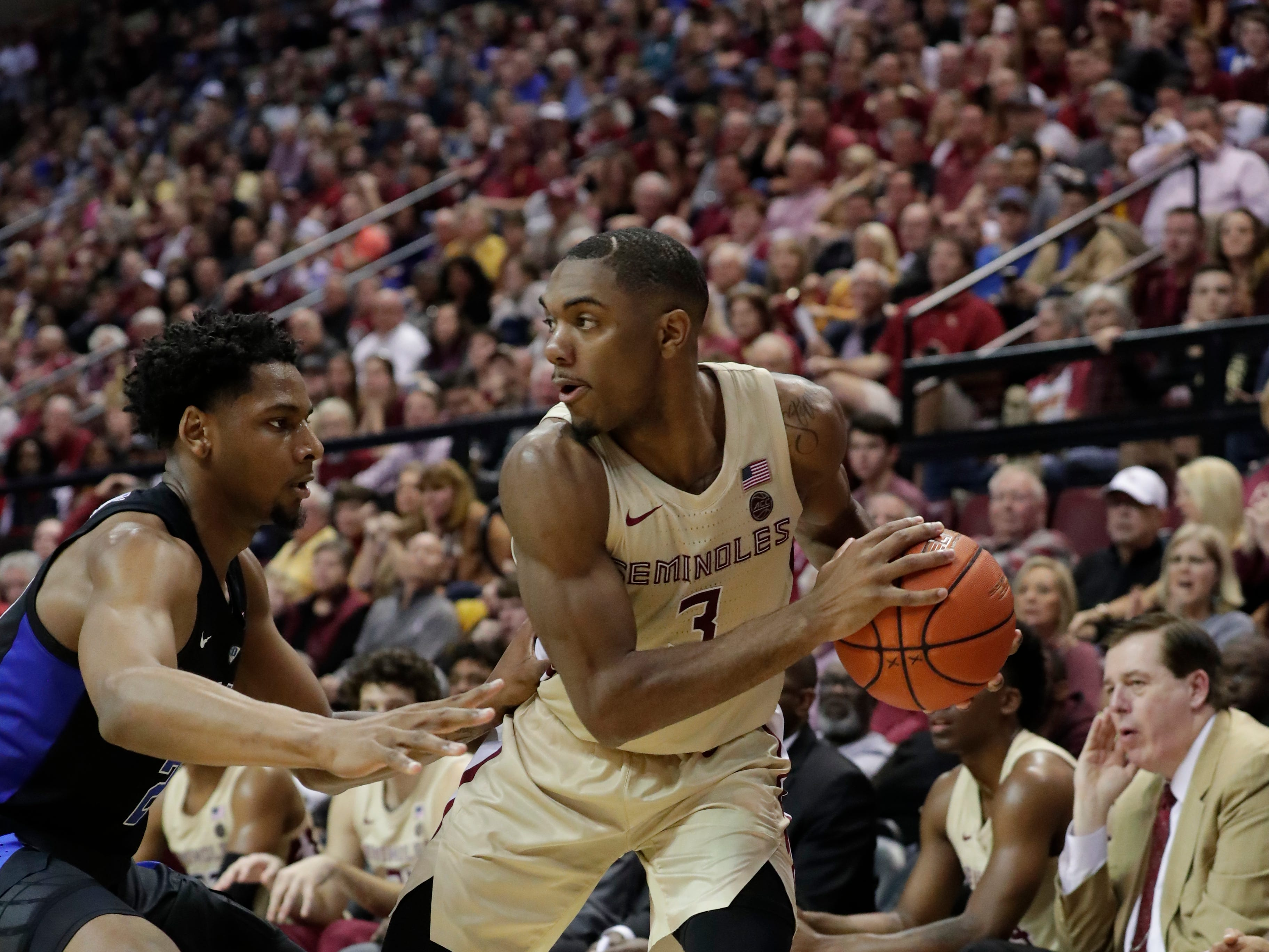 Florida State Seminoles guard Trent Forrest (3) keeps the ball away from his defender while looking to pass to a teammate. Ranked 13 in the ACC, the Florida State Seminoles host the number 1 team, the Duke Blue Devils, at the Tucker Civic Center, Saturday, Jan. 12, 2019.