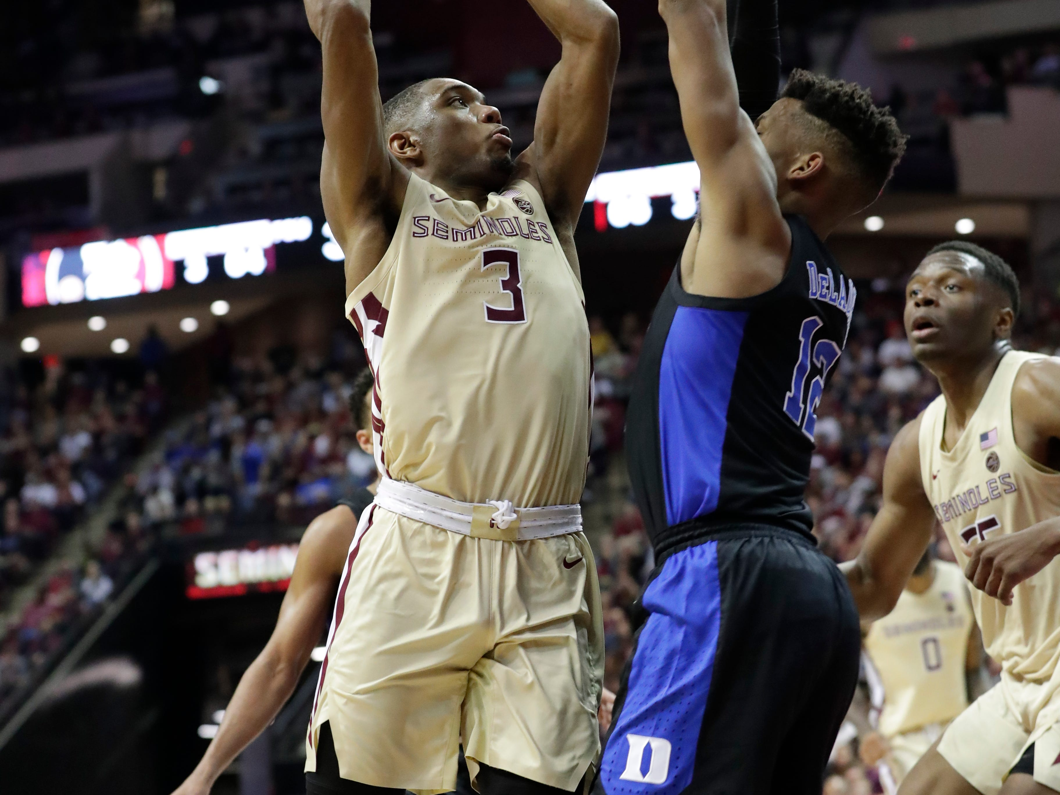 Florida State Seminoles guard Trent Forrest (3) shoots from inside the paint over Duke Blue Devils forward Javin DeLaurier (12). Ranked 13 in the ACC, the Florida State Seminoles host the number 1 team, the Duke Blue Devils, at the Tucker Civic Center, Saturday, Jan. 12, 2019.