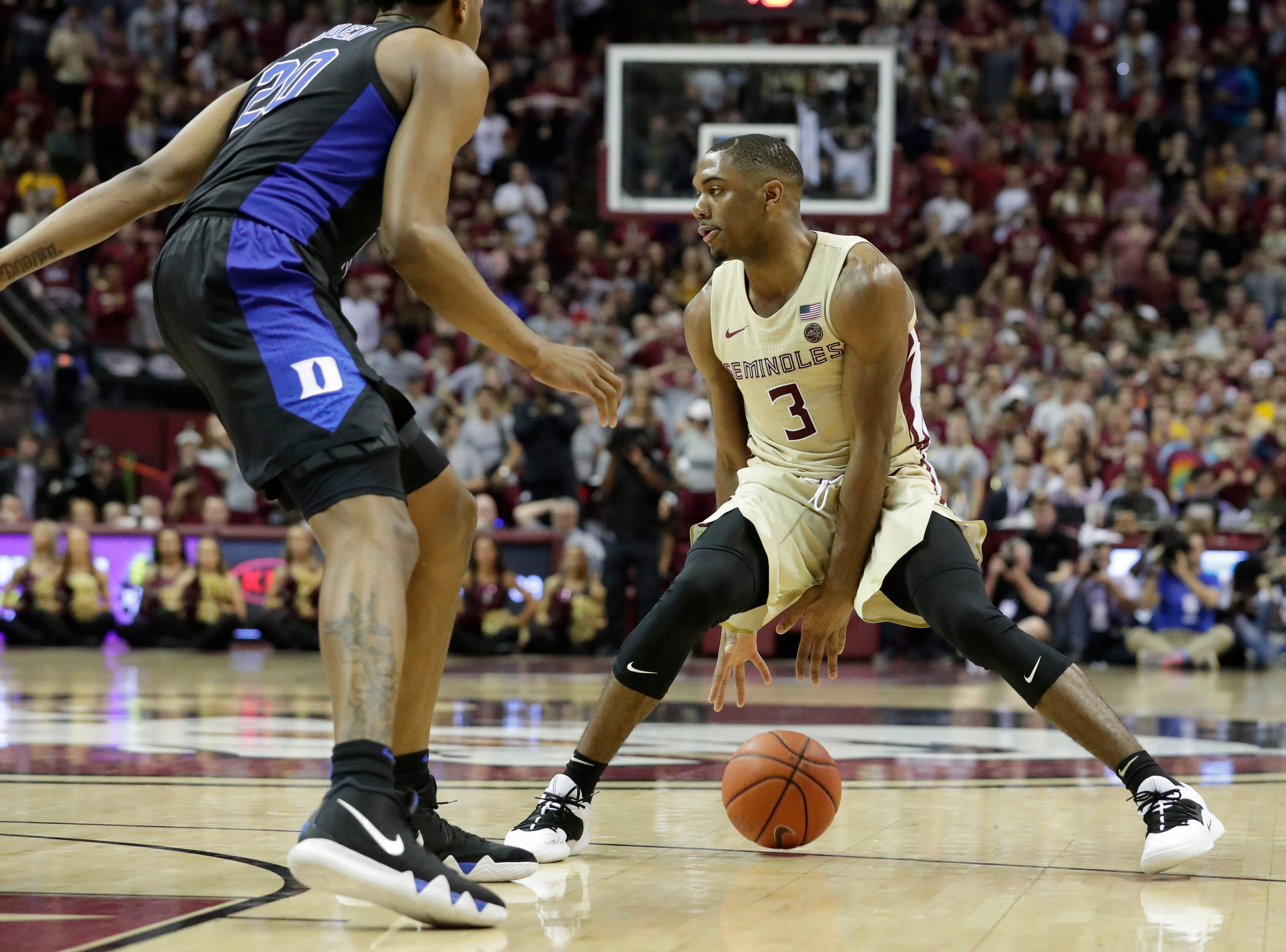 Florida State Seminoles guard Trent Forrest (3) dribbles the ball between his legs. Ranked 13 in the ACC, the Florida State Seminoles host the number 1 team, the Duke Blue Devils, at the Tucker Civic Center, Saturday, Jan. 12, 2019.