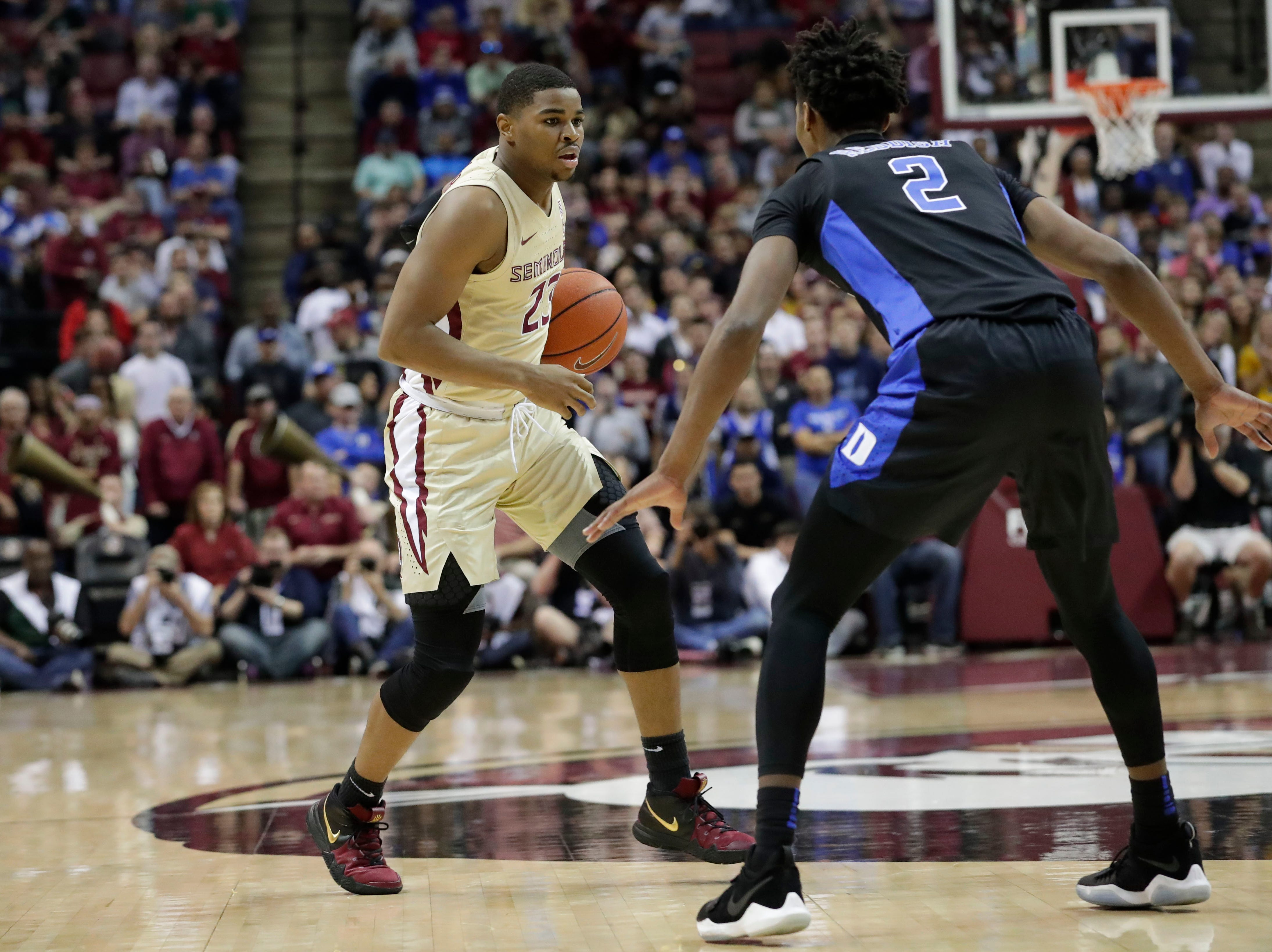 Florida State Seminoles guard M.J. Walker (23) drives the ball down the court with Duke Blue Devils forward Cam Reddish (2) staying on top of him. Ranked 13 in the ACC, the Florida State Seminoles host the number 1 team, the Duke Blue Devils, at the Tucker Civic Center, Saturday, Jan. 12, 2019.