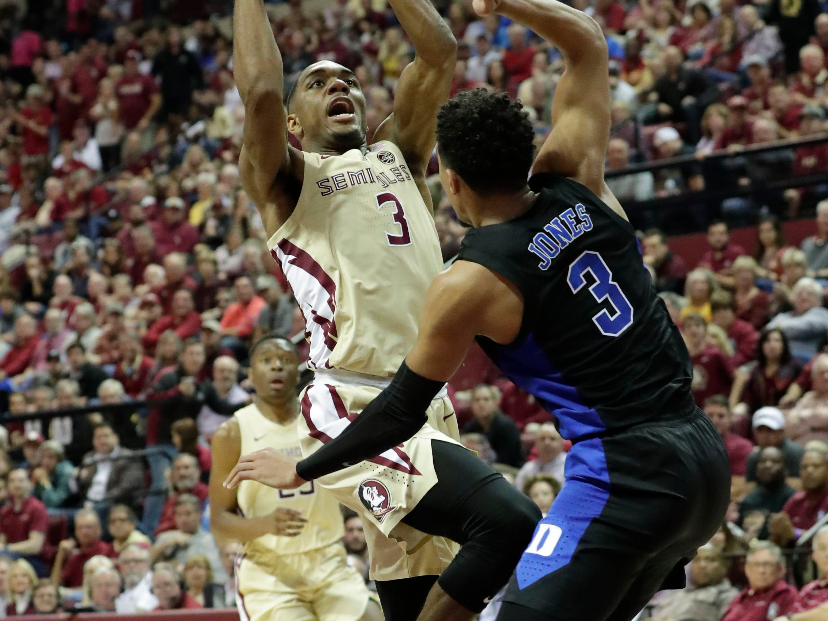 Florida State Seminoles guard Trent Forrest (3) shoots from inside the paint over Duke Blue Devils guard Tre Jones (3). Ranked 13 in the ACC, the Florida State Seminoles host the number 1 team, the Duke Blue Devils, at the Tucker Civic Center, Saturday, Jan. 12, 2019.